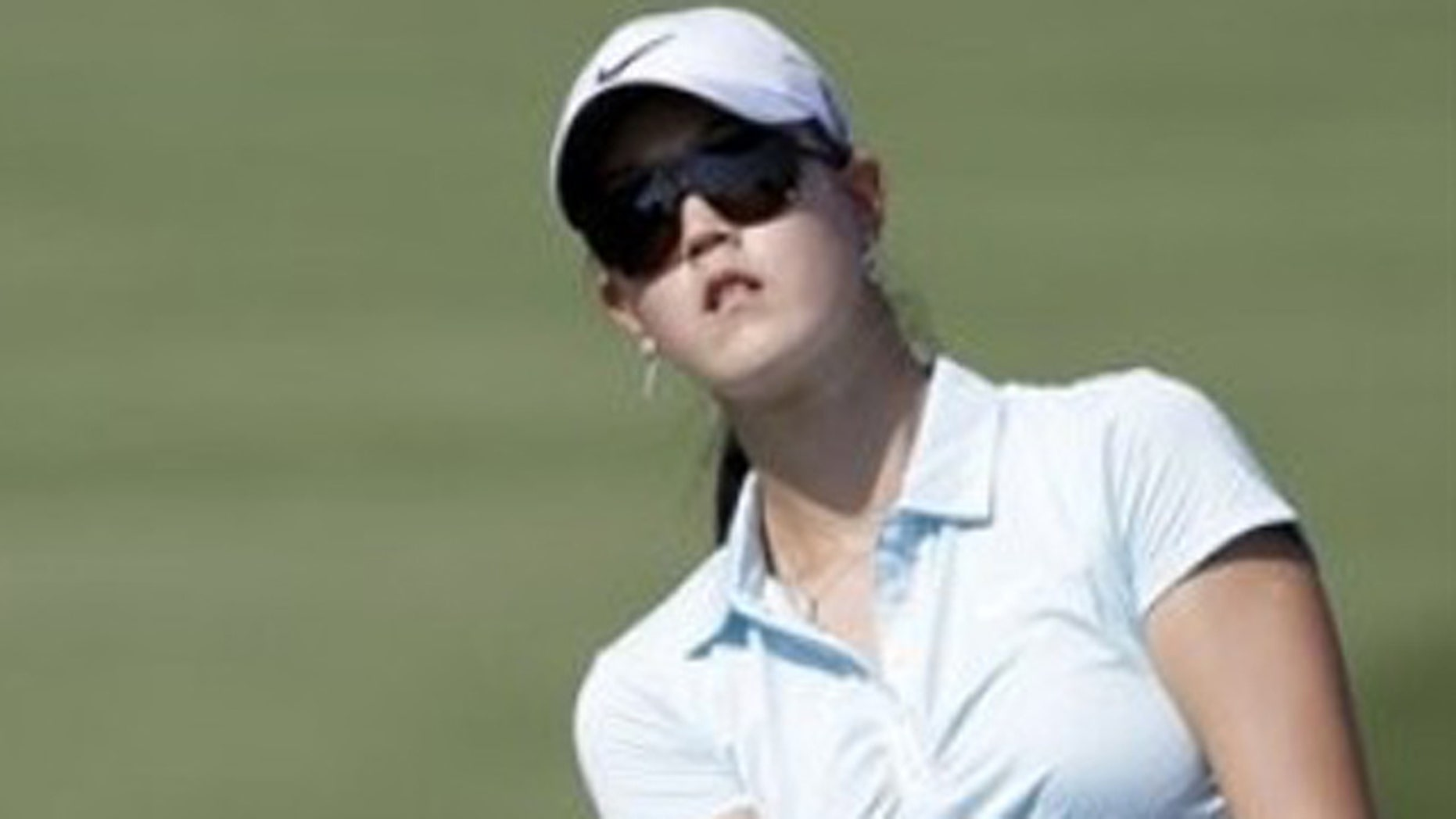 Michelle Wie follows her ball during the third round of the Omega Dubai Ladies Masters held at the Emirates Golf Club, Dubai, UAE, on Friday, Dec 10, 2010.