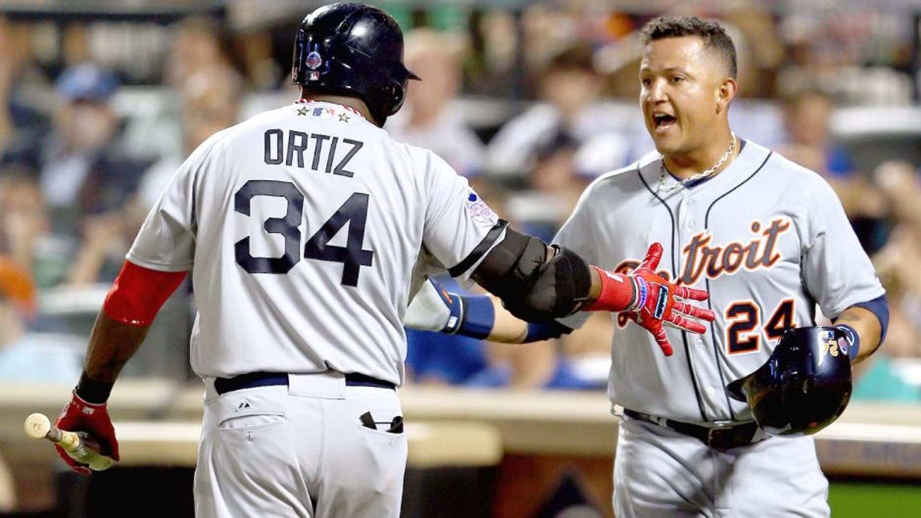 NEW YORK, NY - JULY 16: American League All-Star David Ortiz #34 of the Boston Red Sox greets American League All-Star Miguel Cabrera #24 of the Detroit Tigers after Cabrera scored in the fourth inning during the 84th MLB All-Star Game on July 16, 2013 at Citi Field in the Flushing neighborhood of the Queens borough of New York City. (Photo by Mike Ehrmann/Getty Images)