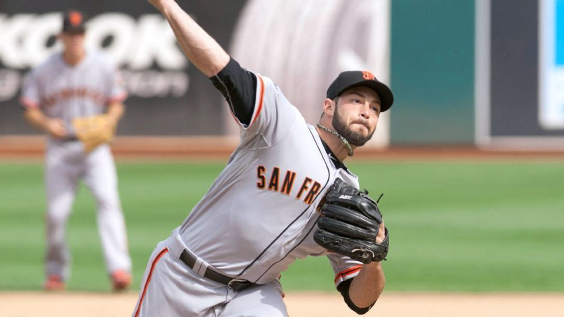 Sep 27, 2015; Oakland, CA, USA; San Francisco Giants relief pitcher George Kontos (70) throws a pitch against the Oakland Athletics during the sixth inning at O.co Coliseum. The San Francisco Giants defeated the Oakland Athletics 5-4. Mandatory Credit: Ed Szczepanski-USA TODAY Sports