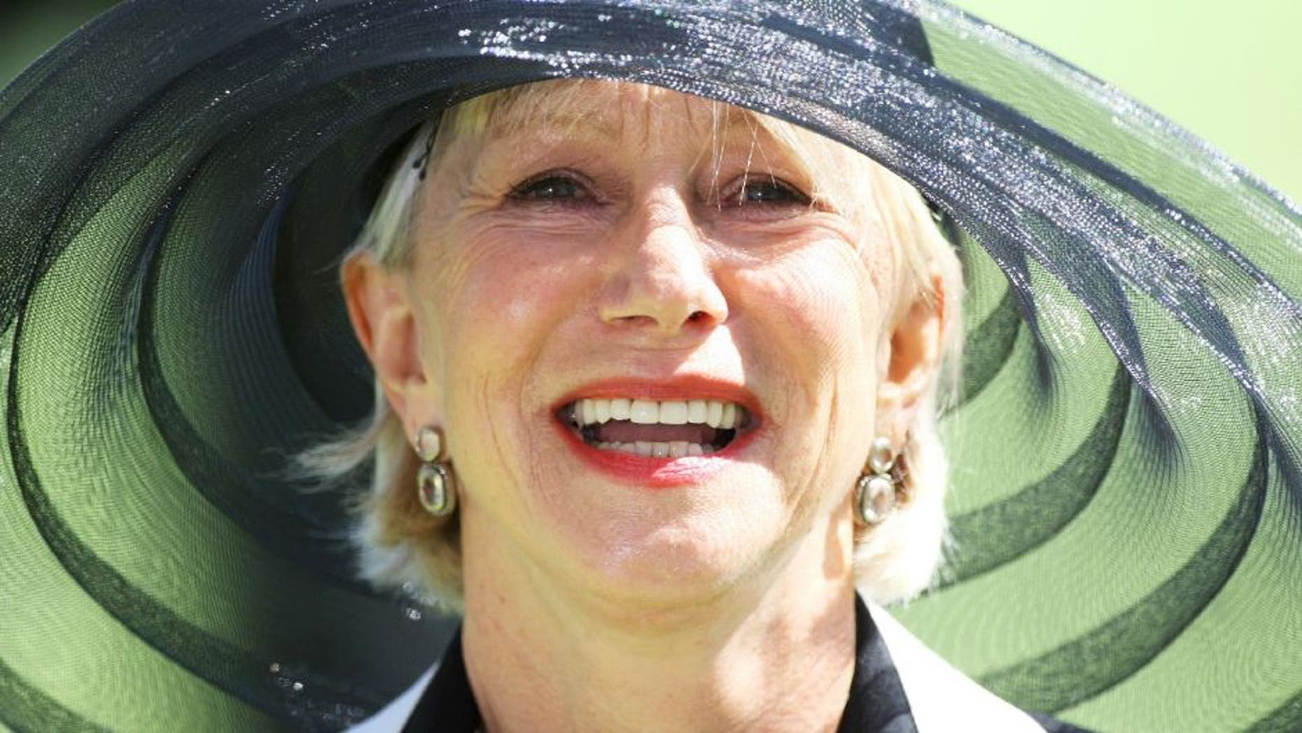 ASCOT, UNITED KINGDOM - JUNE 19: Dame Helen Mirren laughs in the Parade Ring during Ladies Day on June 19, 2008 in Ascot, England. (Photo by Chris Jackson/Getty Images)