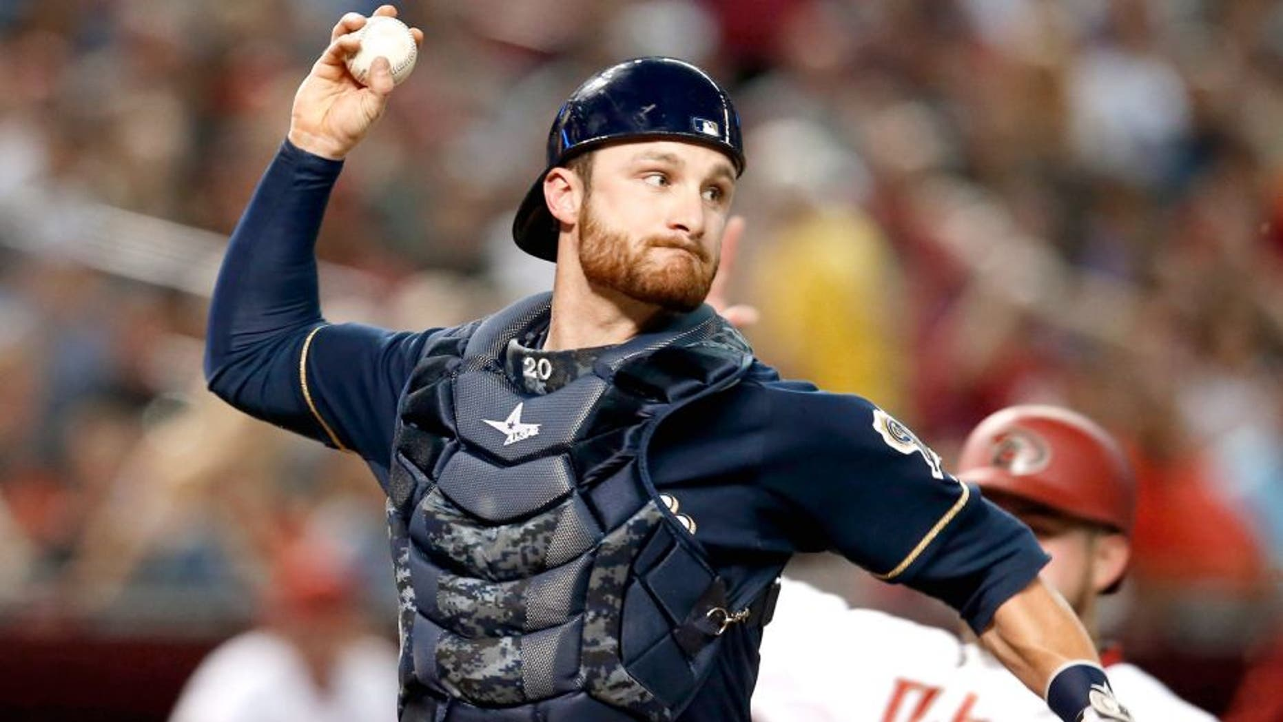 Jul 24, 2015; Phoenix, AZ, USA; Milwaukee Brewers catcher Jonathan Lucroy (20) turns the double play while avoiding Arizona Diamondbacks right fielder Ender Inciarte (5) in the third inning at Chase Field. Mandatory Credit: Rick Scuteri-USA TODAY Sports