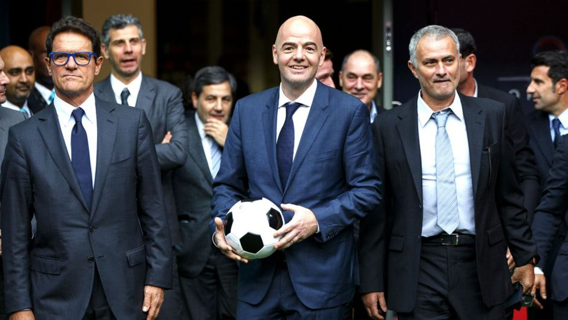 LONDON, UNITED KINGDOM - FEBRUARY 01: FIFA Presidential candidate Gianni Infantino (C) walks with Fabio Capello (L) and former Chelsea manager Jose Mourinho (R) after Gianni Infantino's press conference at Wembley Stadium on February 1, 2016 in London, United Kingdom. Gianni Infantino unveils his 90 day plan that he will implement if he is elected as FIFA President. (Photo by Tolga Akmen/Anadolu Agency/Getty Images)
