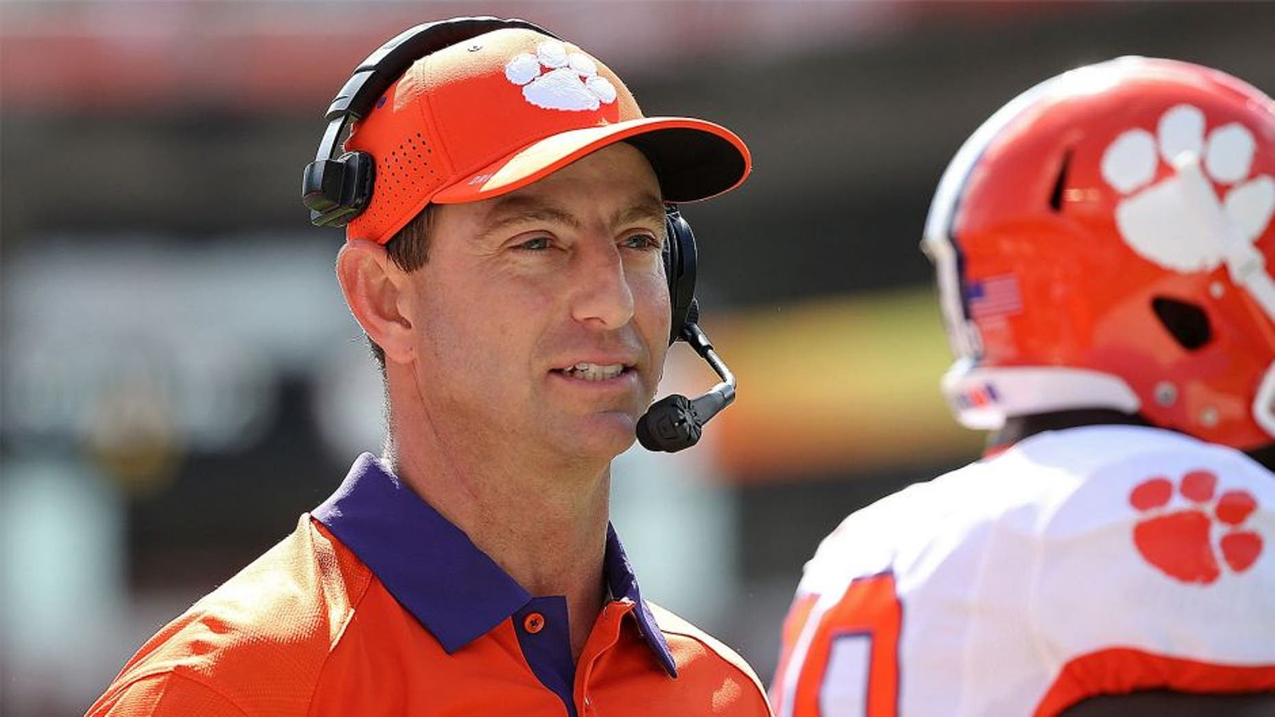 MIAMI GARDENS, FL - OCTOBER 24: Head coach Dabo Swinney of the Clemson Tigers reacts to a play during a game against the Miami Hurricanes at Sun Life Stadium on October 24, 2015 in Miami Gardens, Florida. (Photo by Mike Ehrmann/Getty Images)