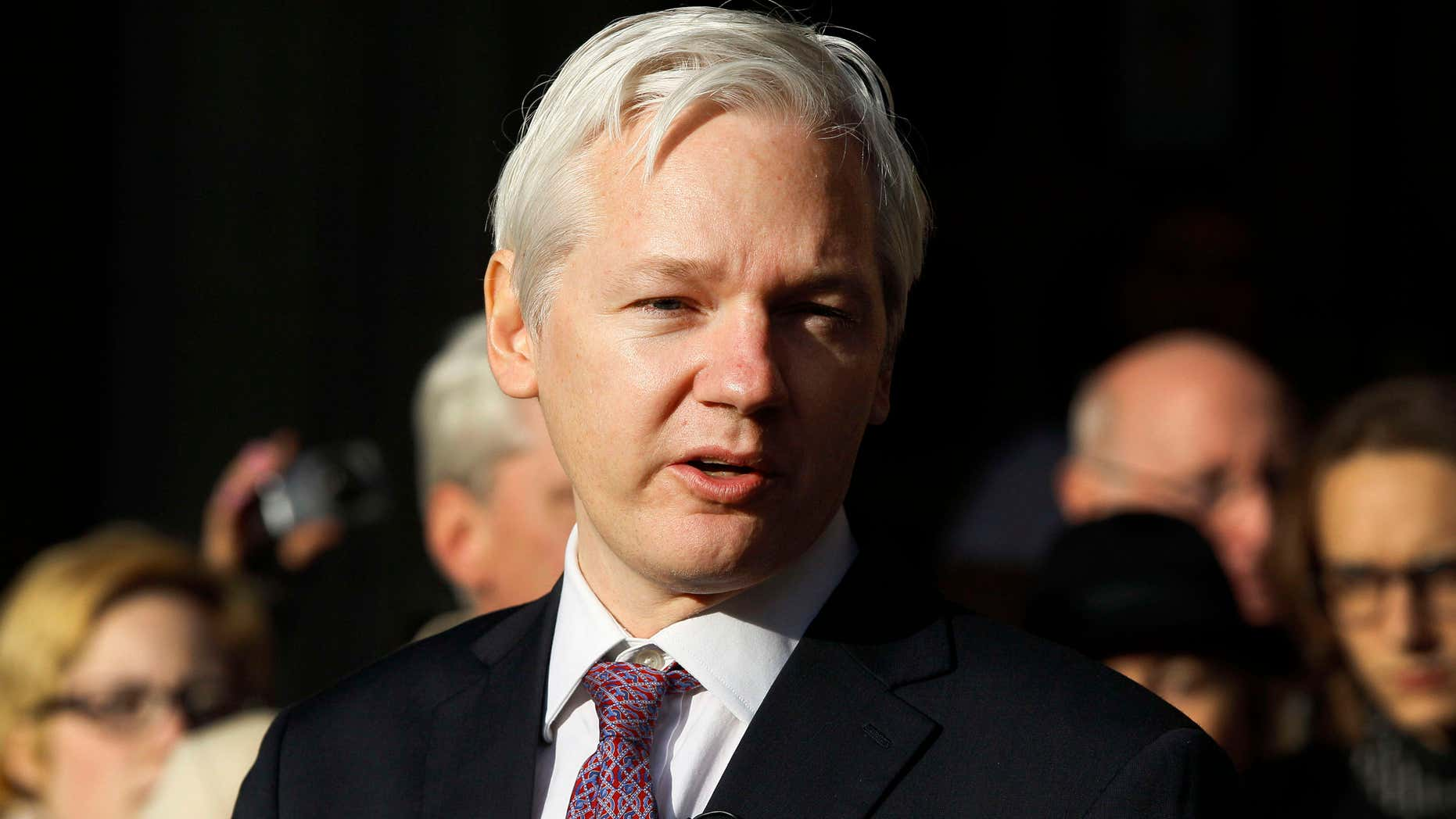 FILE - In this Dec. 5, 2011 file photo, WikiLeaks founder Julian Assange makes a statement to media gathered outside the High Court in London.