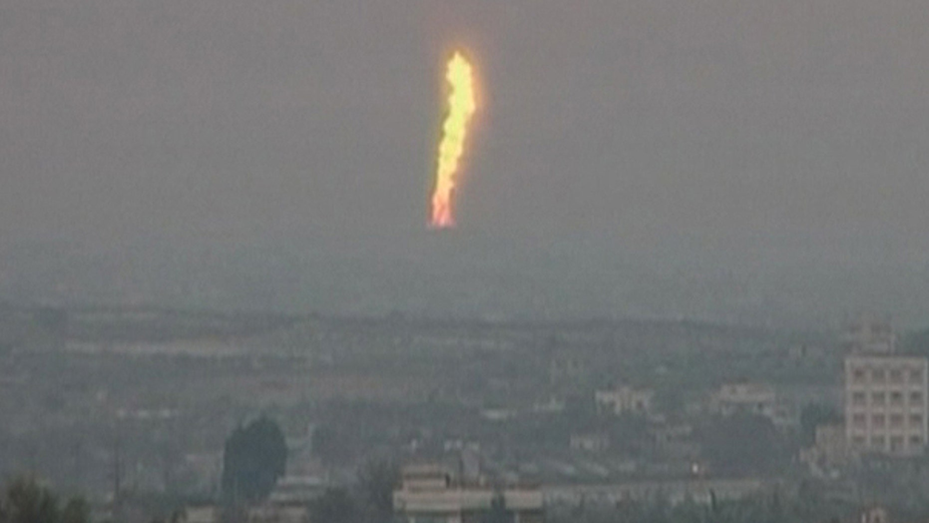 Feb. 5: In this image taken from Associated Press Television News video, a fire is seen after an explosion went off at a gas terminal in Egypt's northern Sinai Peninsula, setting off a massive fire along a gas pipeline that could be seen dozens of miles away, officials and witnesses said.
