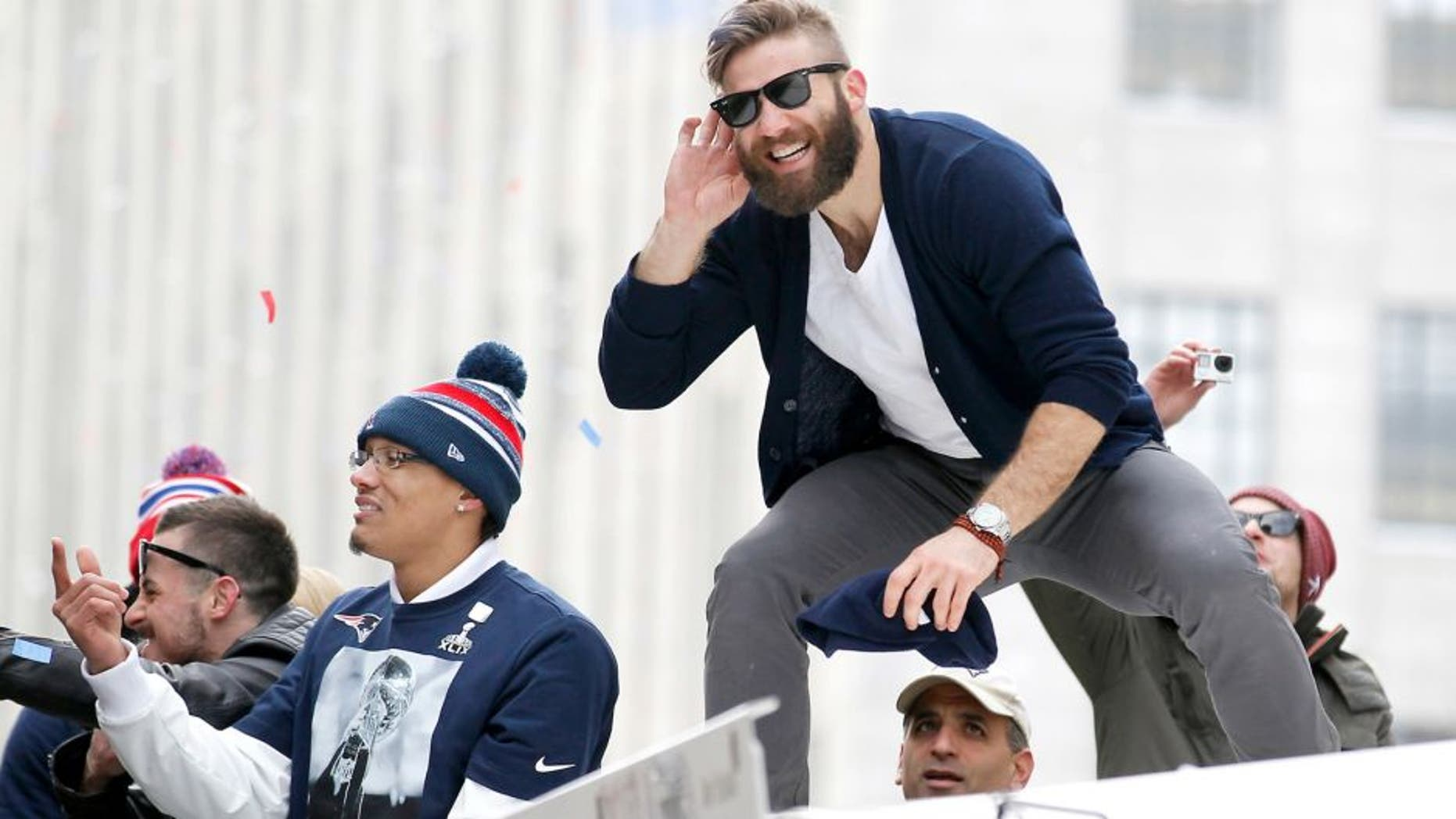 Feb 4, 2015; Boston, MA, USA; New England Patriots wide receiver Julian Edelman gestures to the fans during the Super Bowl XLIX victory parade. Mandatory Credit: Stew Milne-USA TODAY Sports