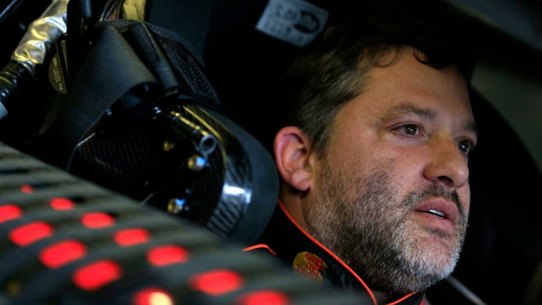 BROOKLYN, MI - JUNE 13: Tony Stewart, driver of the #14 Bass Pro Shops / Mobil 1 Chevrolet, sits in his car during practice for the NASCAR Sprint Cup Series Quicken Loans 400 at Michigan International Speedway on June 13, 2015 in Brooklyn, Michigan. (Photo by Chris Trotman/Getty Images)