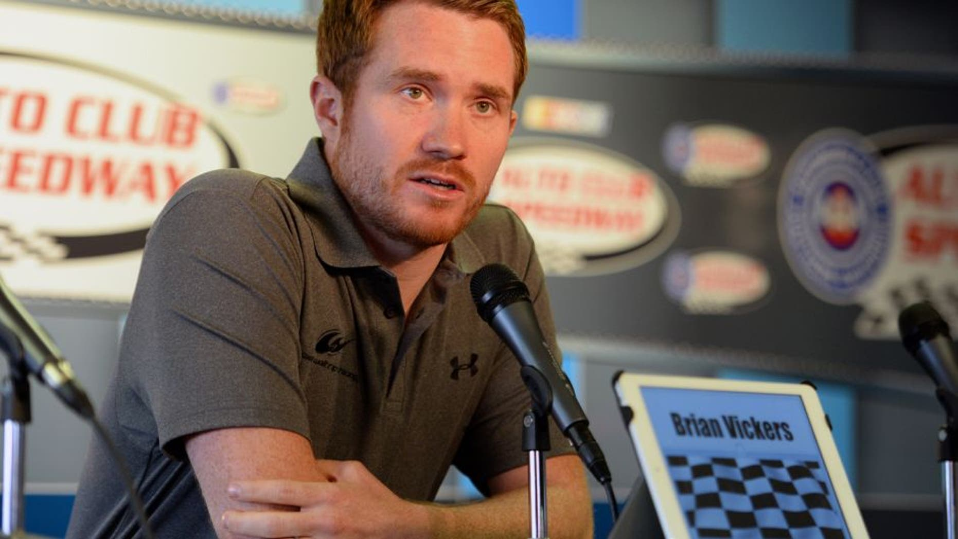 FONTANA, CA - MARCH 22: Brian Vickers, driver of the Michael Waltrip Racing Toyota, answers questions from media during a press conference before the NASCAR Sprint Cup Series Auto Club 400 at Auto Club Speedway on March 22, 2015 in Fontana, California. Vickers was forced to withdraw from competition due to blood clots. (Photo by Robert Laberge/Getty Images)