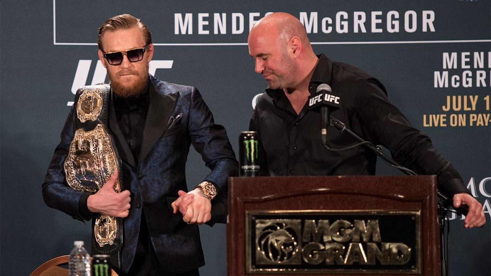 LAS VEGAS, NV - JULY 11: UFC President Dana White (R) greets UFC interim featherweight champion Conor McGregor during the UFC 189 post fight press conference at the MGM Grand Garden Arena on July 11, 2015 in Las Vegas, Nevada. (Photo by Jeff Bottari/Zuffa LLC/Zuffa LLC via Getty Images)