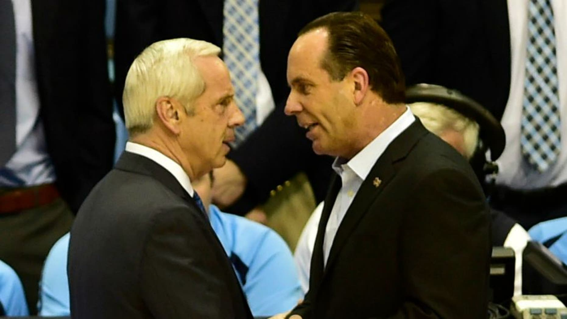 Jan 5, 2015; Chapel Hill, NC, USA; North Carolina Tar Heels head coach Roy Williams and Notre Dame Fighting Irish head coach Mike Brey greet each other before the game at Dean E. Smith Center. Mandatory Credit: Bob Donnan-USA TODAY Sports