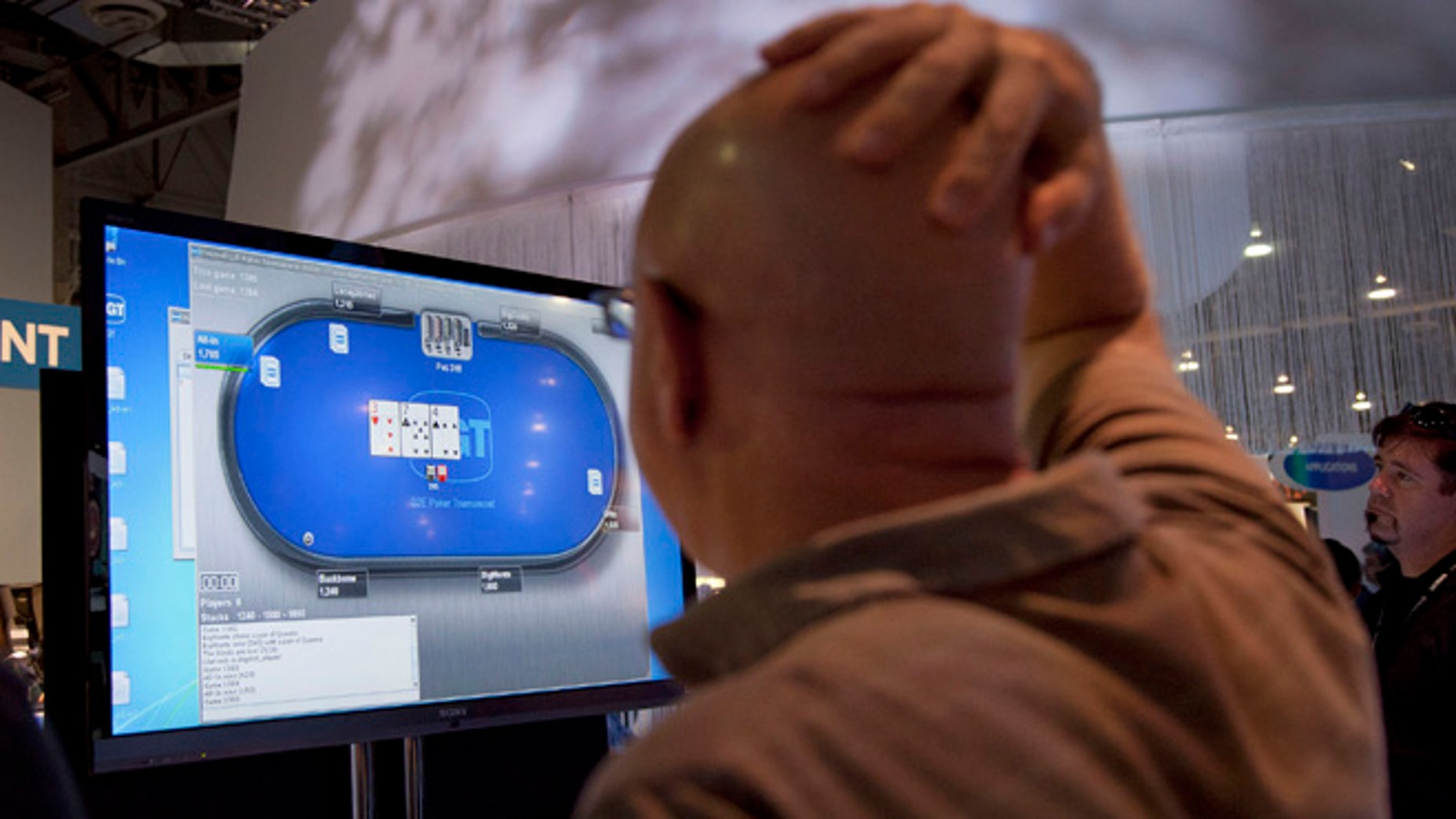 FILE - This Oct. 4, 2011 file photo shows an online poker player playing a game during industry's G2E conference in Las Vegas.