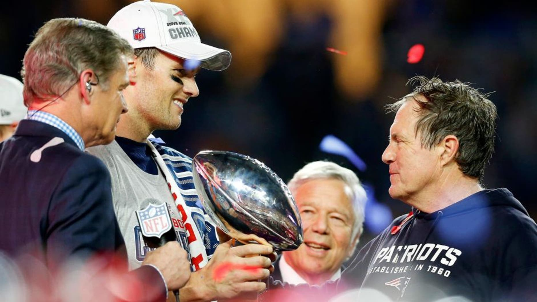 GLENDALE, AZ - FEBRUARY 01: Tom Brady #12, team owner Robert Kraft, and head coach Bill Belichick of the New England Patriots celebrate with the Vince Lombardi Trophy after defeating the Seattle Seahawks 28-24 to win Super Bowl XLIX at University of Phoenix Stadium on February 1, 2015 in Glendale, Arizona. (Photo by Tom Pennington/Getty Images)