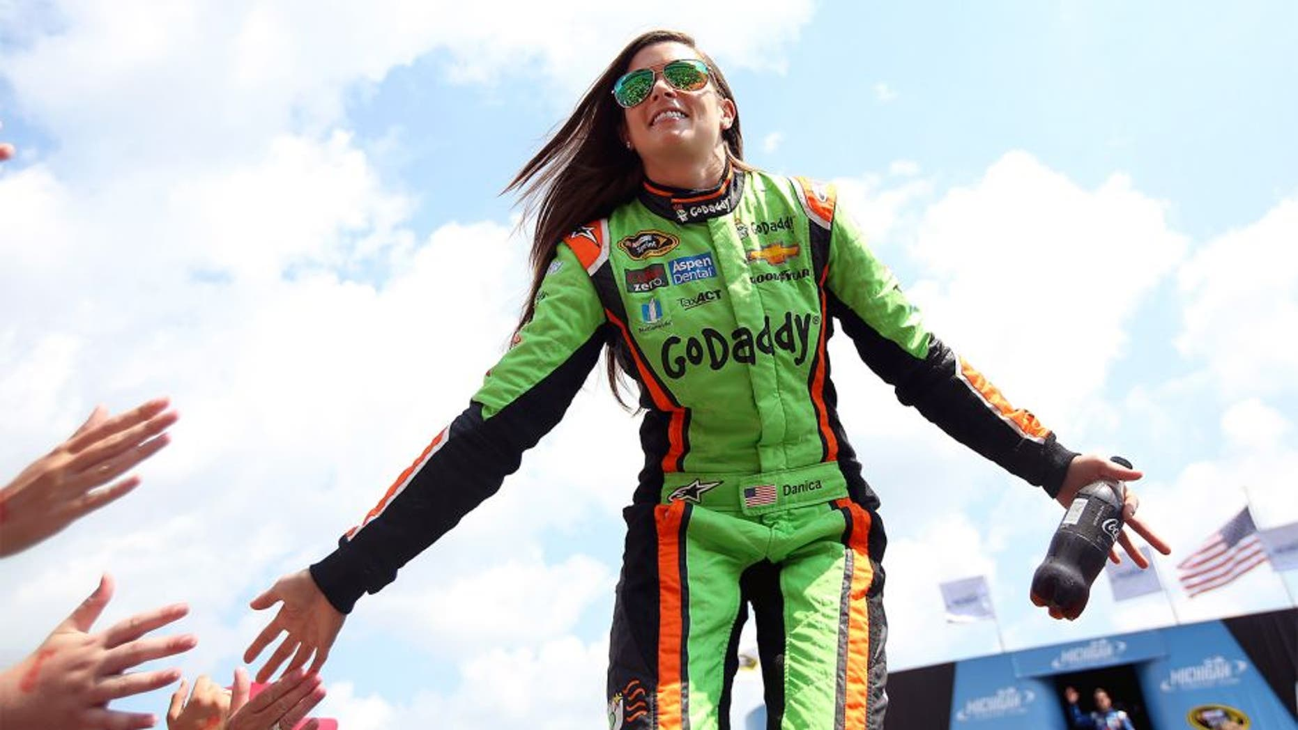 BROOKLYN, MI - AUGUST 16: Danica Patrick, driver of the #10 GoDaddy Chevrolet, is introduced during pre-race ceremonies before the NASCAR Sprint Cup Series Pure Michigan 400 at Michigan International Speedway on August 16, 2015 in Brooklyn, Michigan. (Photo by Nick Laham/NASCAR via Getty Images)