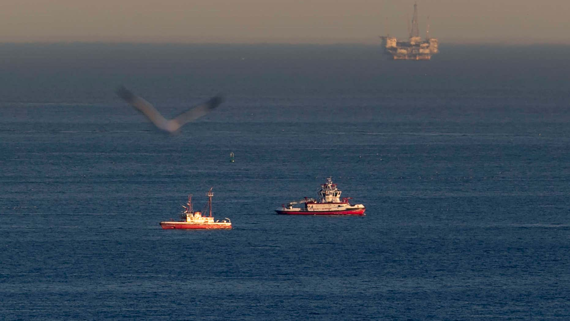 Feb. 5, 2016: Rescue boats search for wreckage from two small planes that collided in midair and plunged into the ocean off of Los Angeles harbor in San Pedro, Calif.