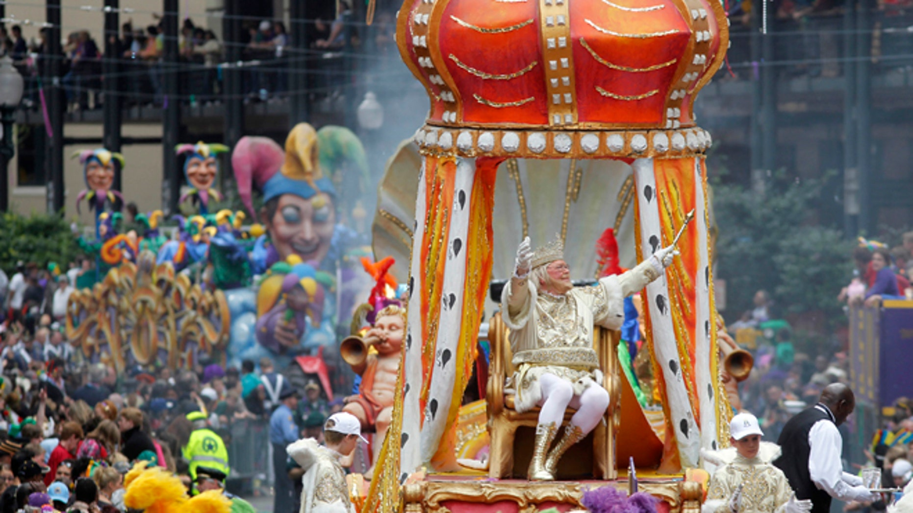 FILE - In this March 8, 2011 file photo, Rex, the King of Carnival rides in the Krewe of Rex as he arrives at Canal St. on Mardi Gras day in New Orleans.