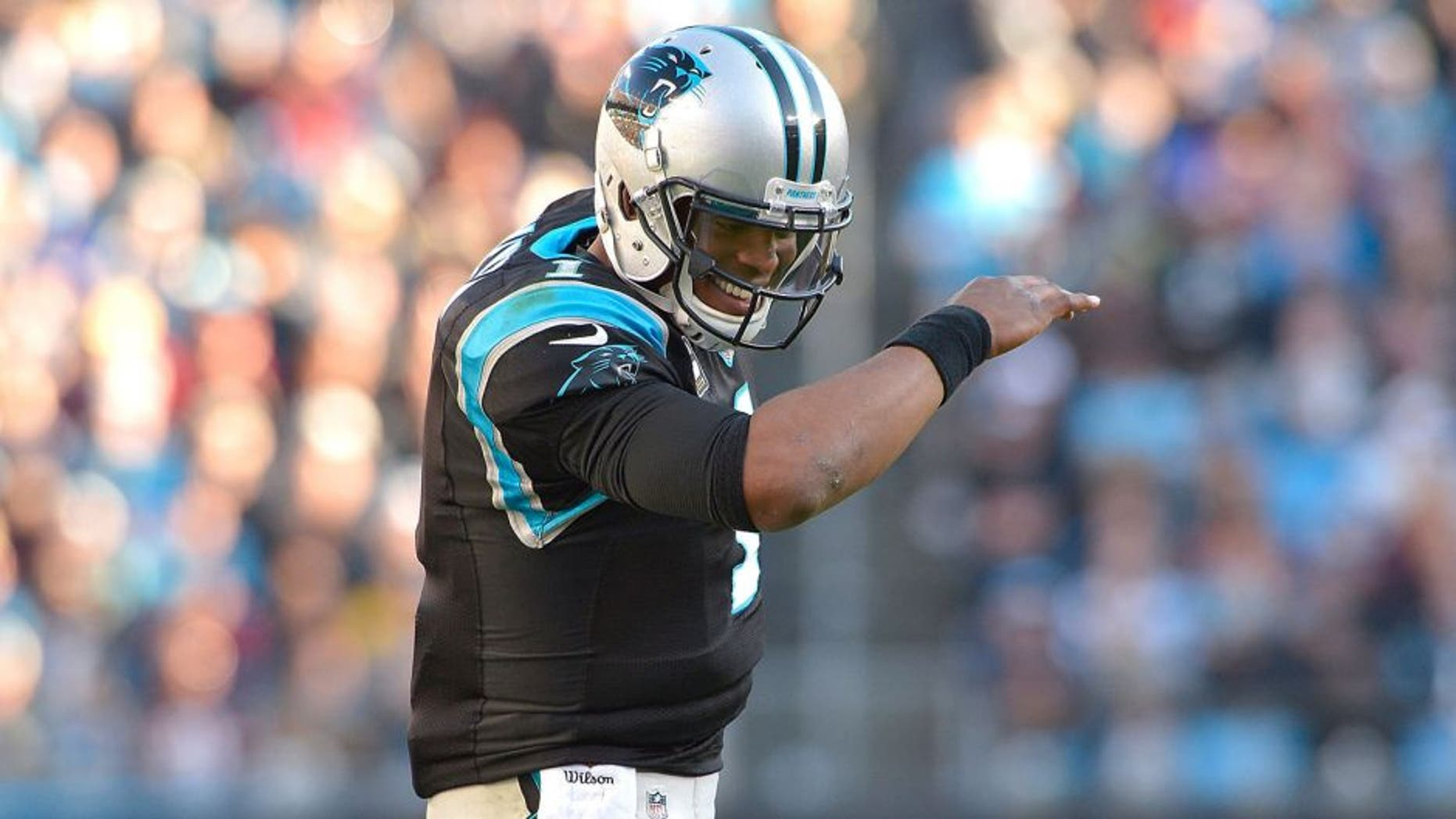 CHARLOTTE, NC - NOVEMBER 22: Cam Newton #1 of the Carolina Panthers does The Dab after a touchdown against the Washington Redskins during their game at Bank of America Stadium on November 22, 2015 in Charlotte, North Carolina. (Photo by Grant Halverson/Getty Images)