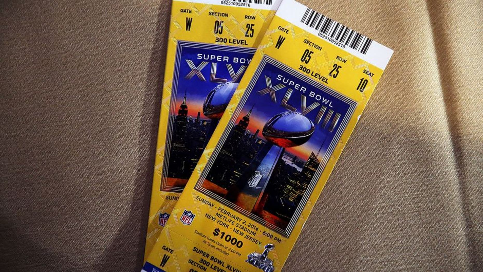 NEW YORK, NY - JANUARY 30: Authentic game tickets are viewed at a news conference on the latest seizure of counterfeit sports-related merchandise leading up to Super Bowl XLVIII on January 30, 2014 in New York City. Officials from the National Football League, U.S. Immigration and Customs Enforcement and U.S. Customs and Border Protection displayed recently confiscated items while also showing phony websites that have been set-up to sell Super Bowl XLVIII merchandise. Counterfeit sports merchandise, much of which originates in China, is a multi million dollar industry. (Photo by Spencer Platt/Getty Images)