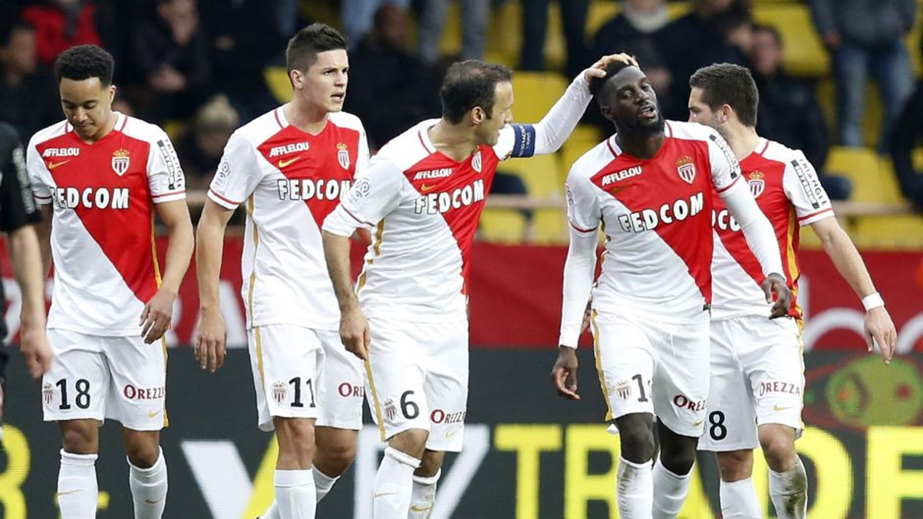Monaco's French Midfielder Tiemoue Bakayoko (2nd R) celebrates with teammates after scoring a goal during the French L1 football match between Monaco (ASM) and Nice (OGCN) at Louis II Stadium in Monaco on February 6, 2016. AFP PHOTO / VALERY HACHE / AFP / VALERY HACHE (Photo credit should read VALERY HACHE/AFP/Getty Images)