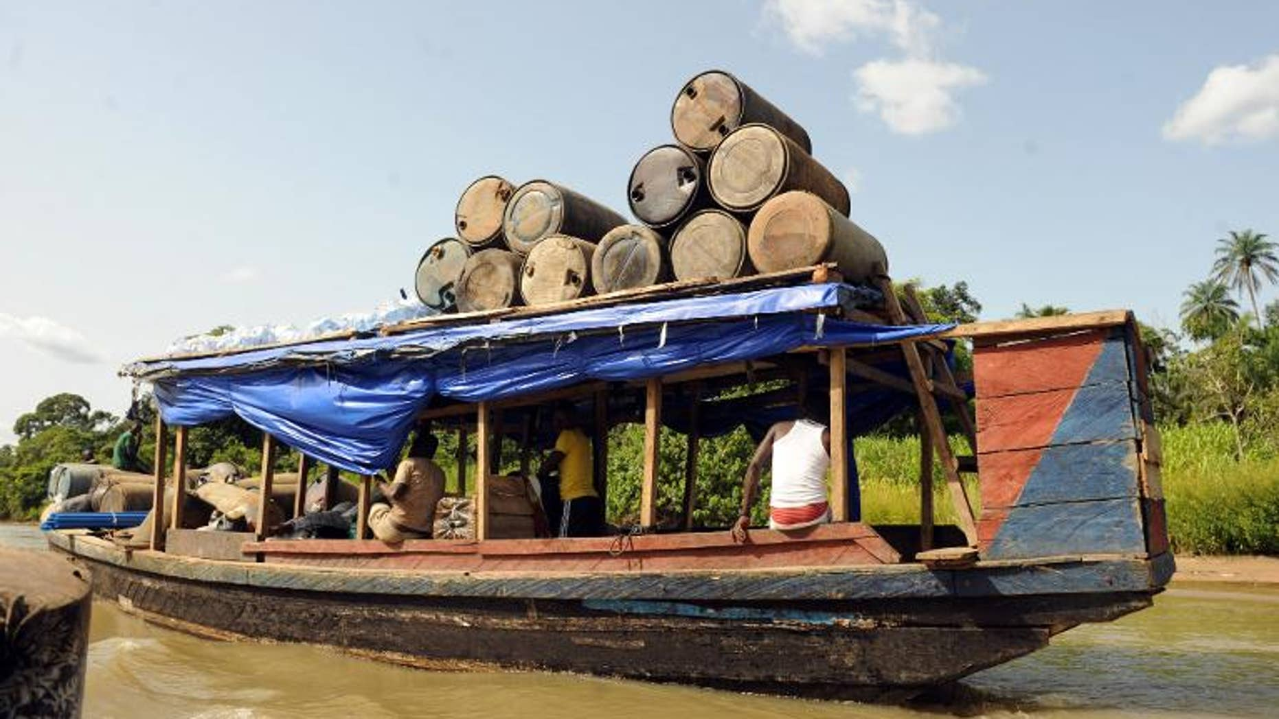 Jerry cans are ferried to the market in Bayelsa State of Niger Delta on April 11, 2013