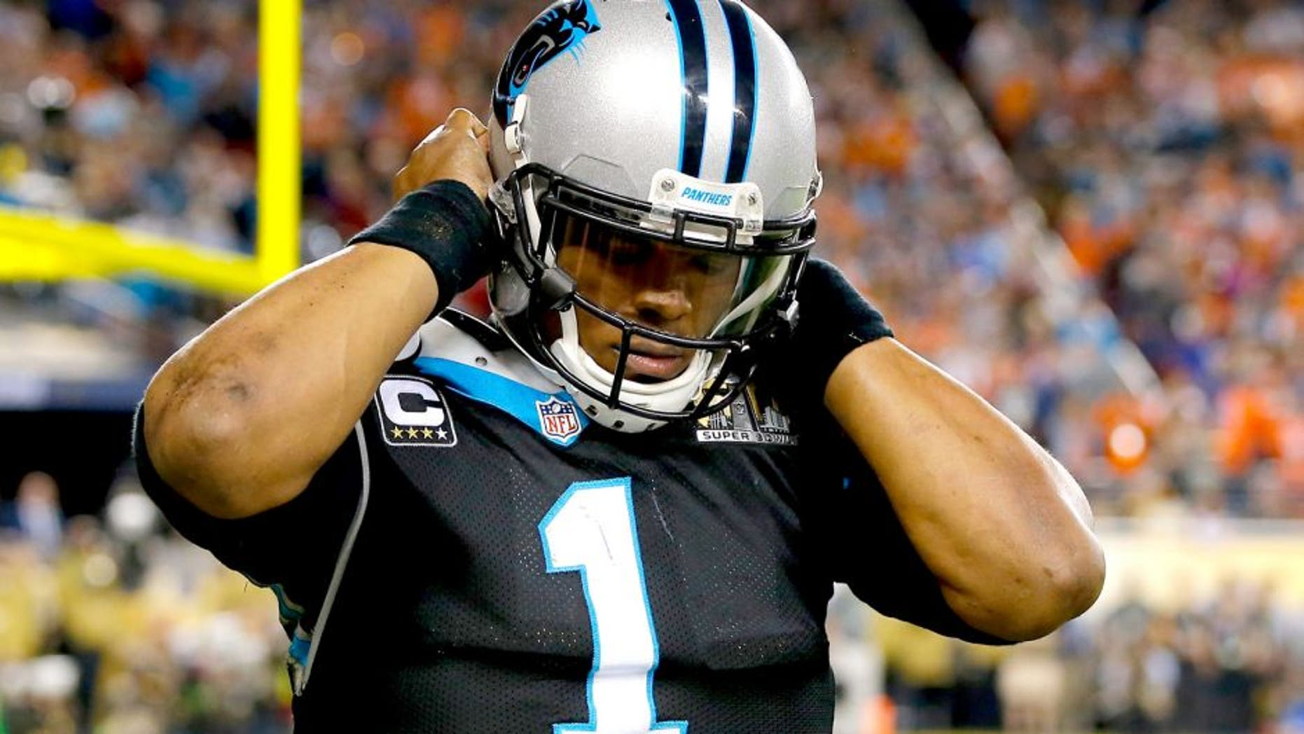 SANTA CLARA, CA - FEBRUARY 07: Cam Newton #1 of the Carolina Panthers reacts after being hit in the fourth quarter of Super Bowl 50 against the Denver Broncos at Levi's Stadium on February 7, 2016 in Santa Clara, California. (Photo by Kevin C. Cox/Getty Images)