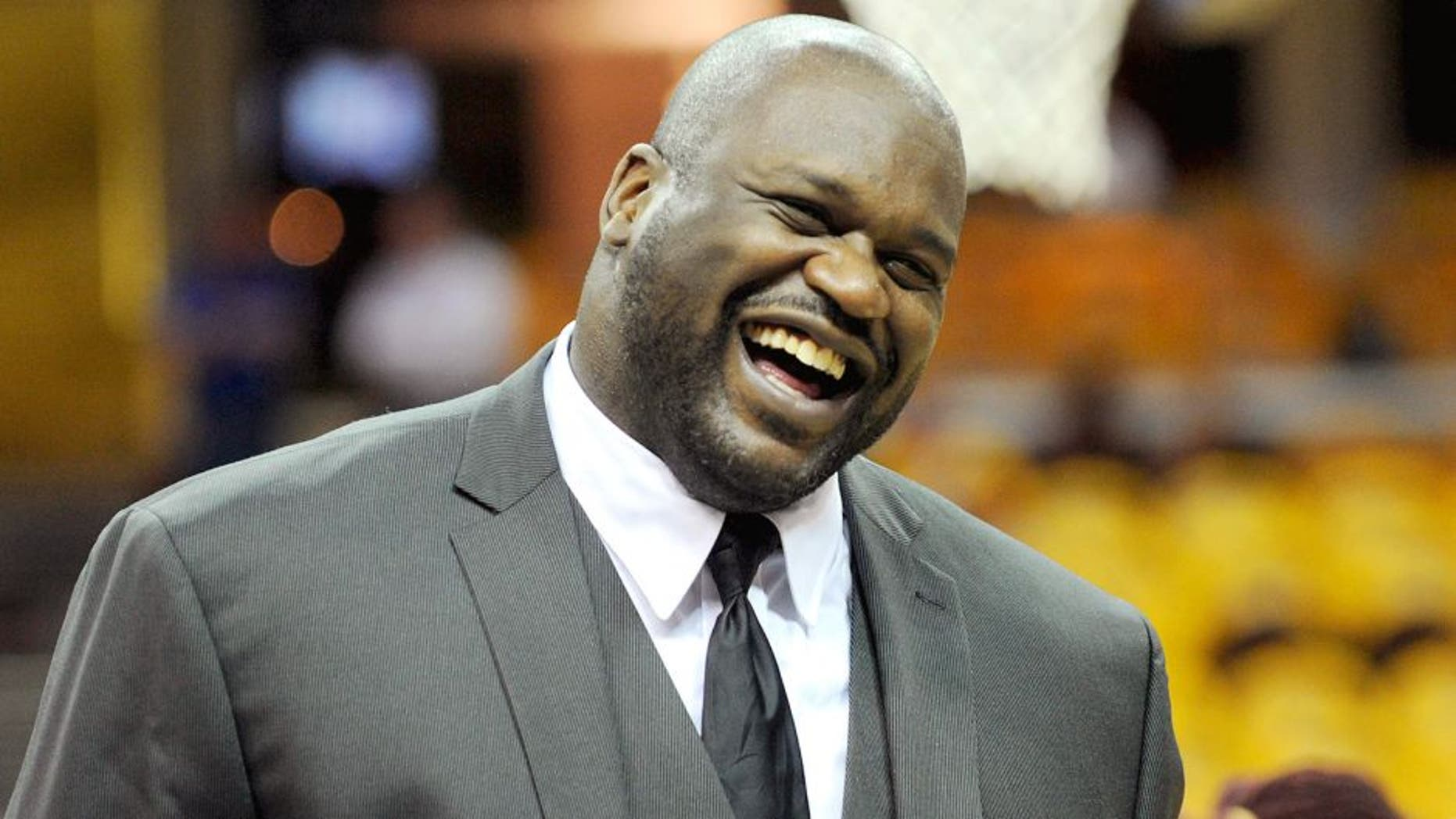 May 26, 2015; Cleveland, OH, USA; TNT analyst Shaquille O'Neal laughs on the court before game four of the Eastern Conference Finals of the NBA Playoffs between the Cleveland Cavaliers and the Atlanta Hawks at Quicken Loans Arena. Mandatory Credit: Ken Blaze-USA TODAY Sports