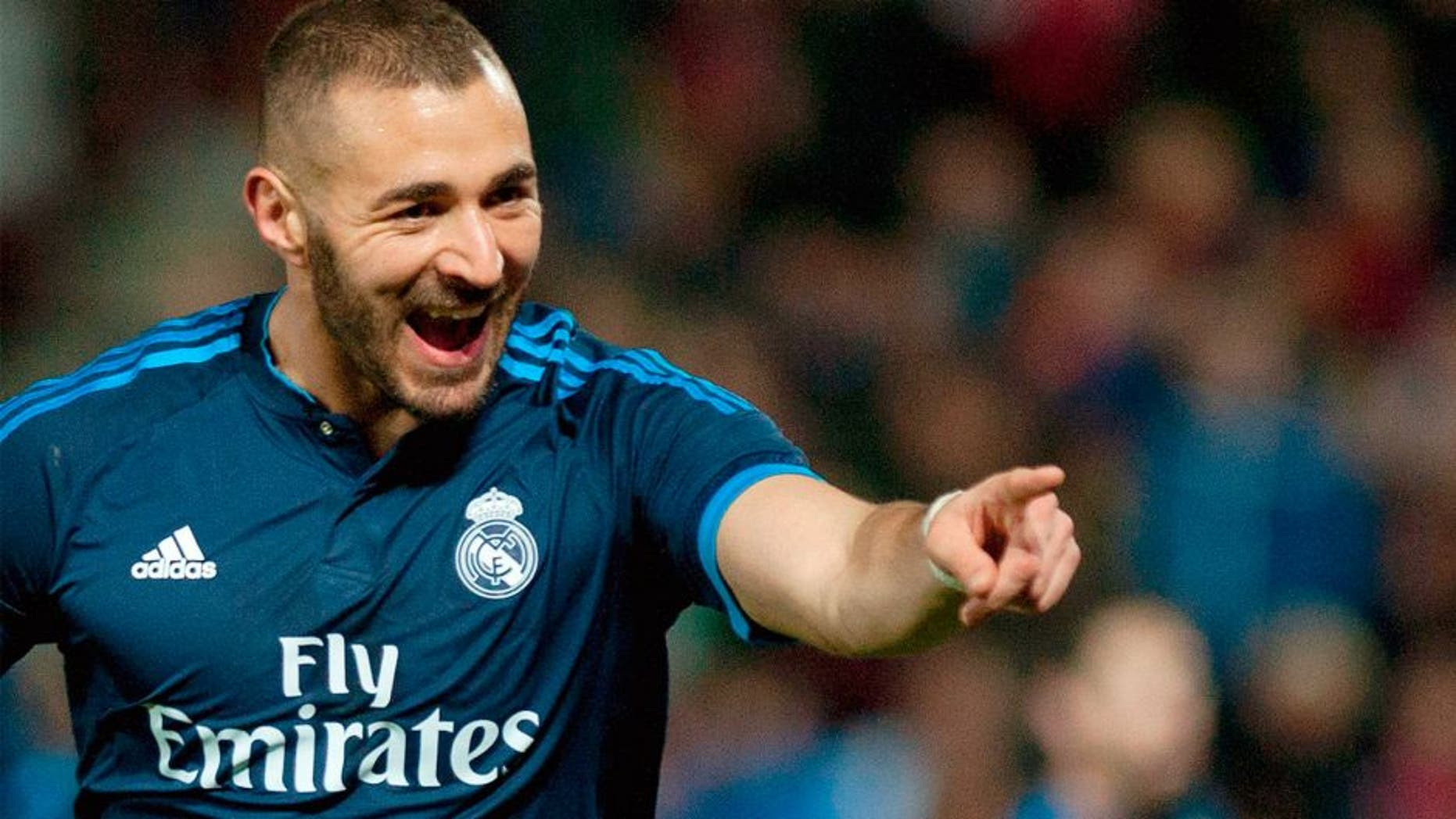 Real Madrid's French forward Karim Benzema celebrates a goal during the Spanish league football match Granada FC vs Real Madrid CF at Nuevo Los Carmenes stadium in Granada on February 7, 2016. AFP PHOTO / JORGE GUERRERO / AFP / Jorge Guerrero (Photo credit should read JORGE GUERRERO/AFP/Getty Images)