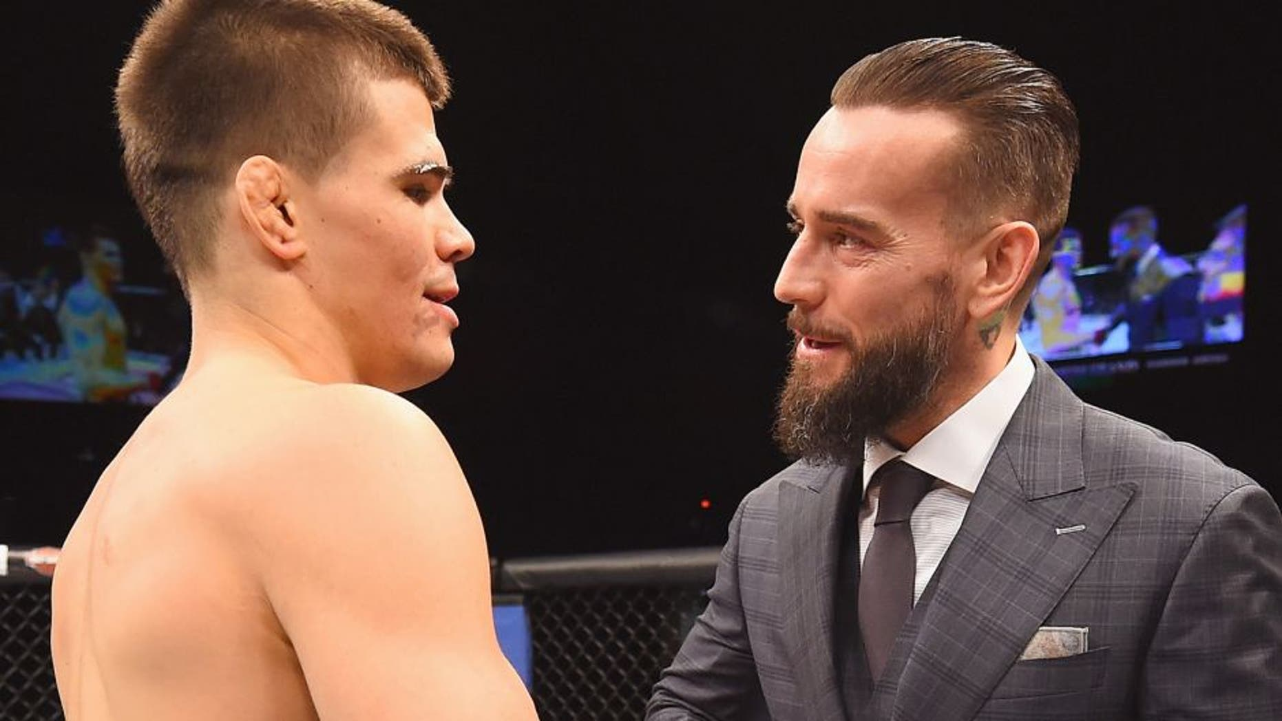 LAS VEGAS, NV - FEBRUARY 06: (R-L) Phil 'CM Punk' Brooks congratulates Mickey Gall after Gall's victory over Mike Jackson during the UFC Fight Night event at MGM Grand Garden Arena on February 6, 2016 in Las Vegas, Nevada. (Photo by Jeff Bottari/Zuffa LLC/Zuffa LLC via Getty Images)