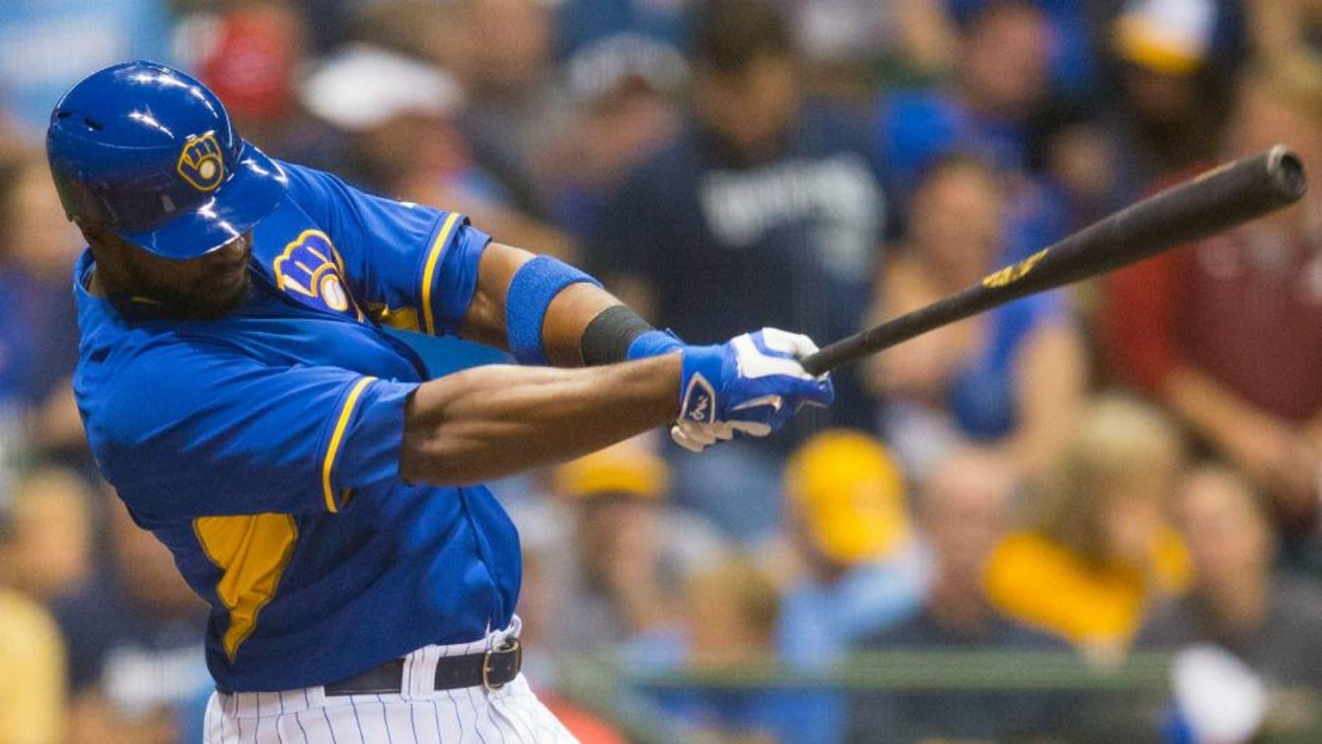 Sep 23, 2016; Milwaukee, WI, USA; Milwaukee Brewers first baseman Chris Carter (33) hits a home run during the second inning against the Cincinnati Reds at Miller Park. Mandatory Credit: Jeff Hanisch-USA TODAY Sports