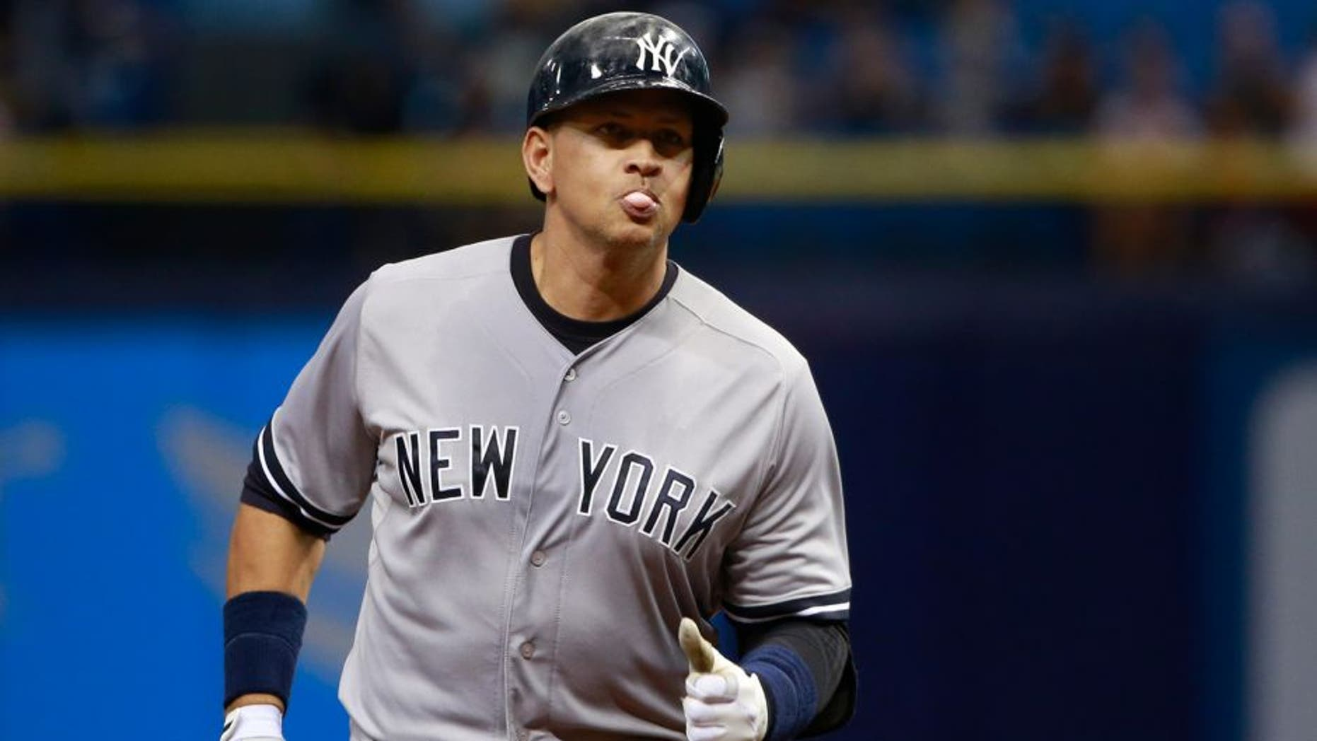 Sep 15, 2015; St. Petersburg, FL, USA; New York Yankees designated hitter Alex Rodriguez (13) hits a solo home run during the first inning against the Tampa Bay Rays at Tropicana Field. Mandatory Credit: Kim Klement-USA TODAY Sports