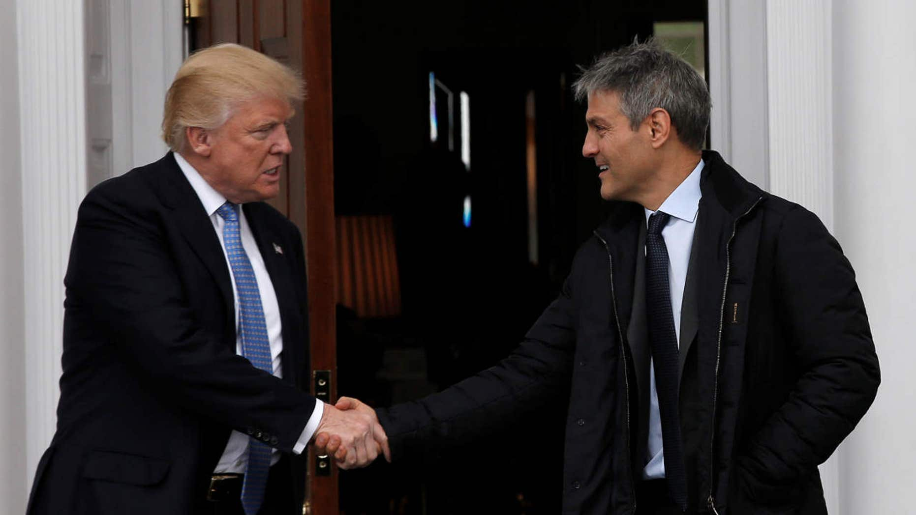 U.S. President-elect Donald Trump emerges with Ari Emanuel after their meeting in at the Trump National Golf Club in Bedminster, N.J.