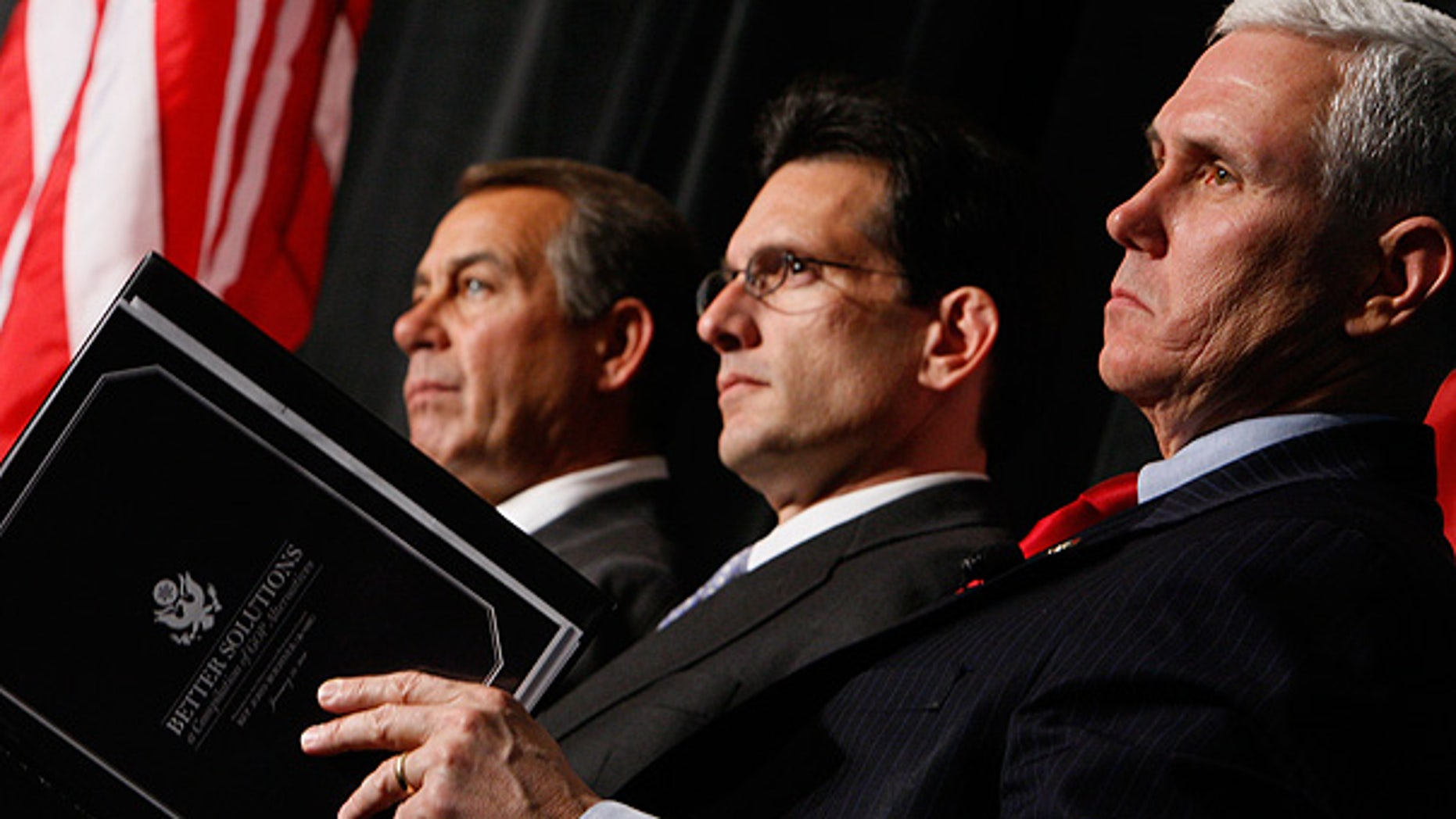 Jan. 29: House Minority Leader John Boehner, left, House Minority Whip Eric Cantor, center, and Rep. Mike Pence listen as President Obama speaks to Republican lawmakers.