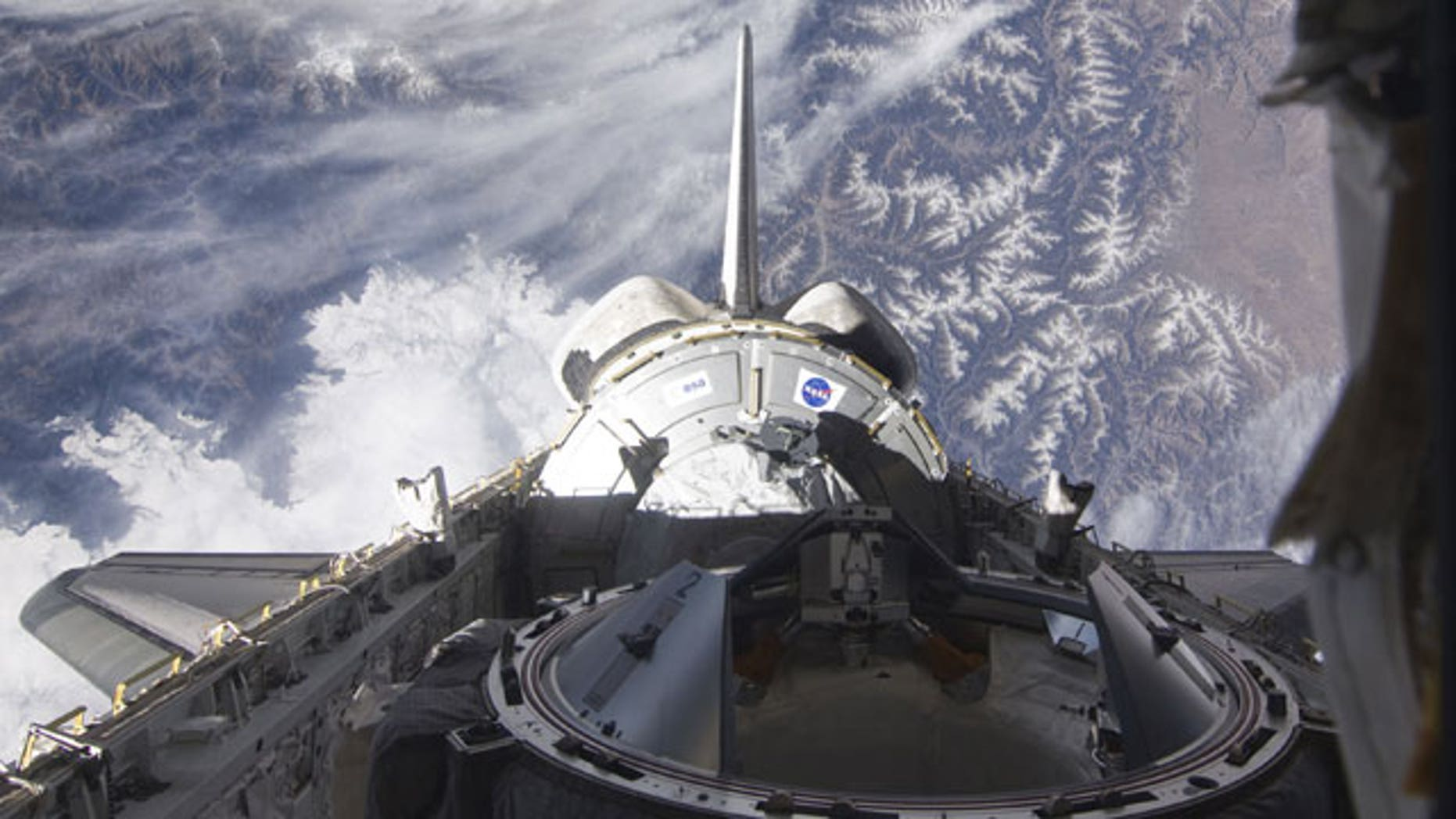 Feb. 9: Endeavour shown above Earth.