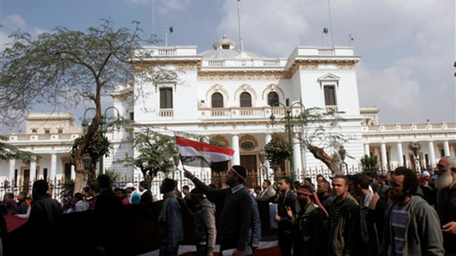 Feb. 9: Protesters wave Egyptian flags in front of the Egyptian Parliament in Cairo, Egypt. Around 2,000 protesters waved huge flags outside the parliament, located several blocks from Tahrir Square, where they moved a day earlier in the movement's first expansion out of the square. They chanted slogans demanding the dissolving of the legislature, where almost all the seats are held by the ruling party. (AP)