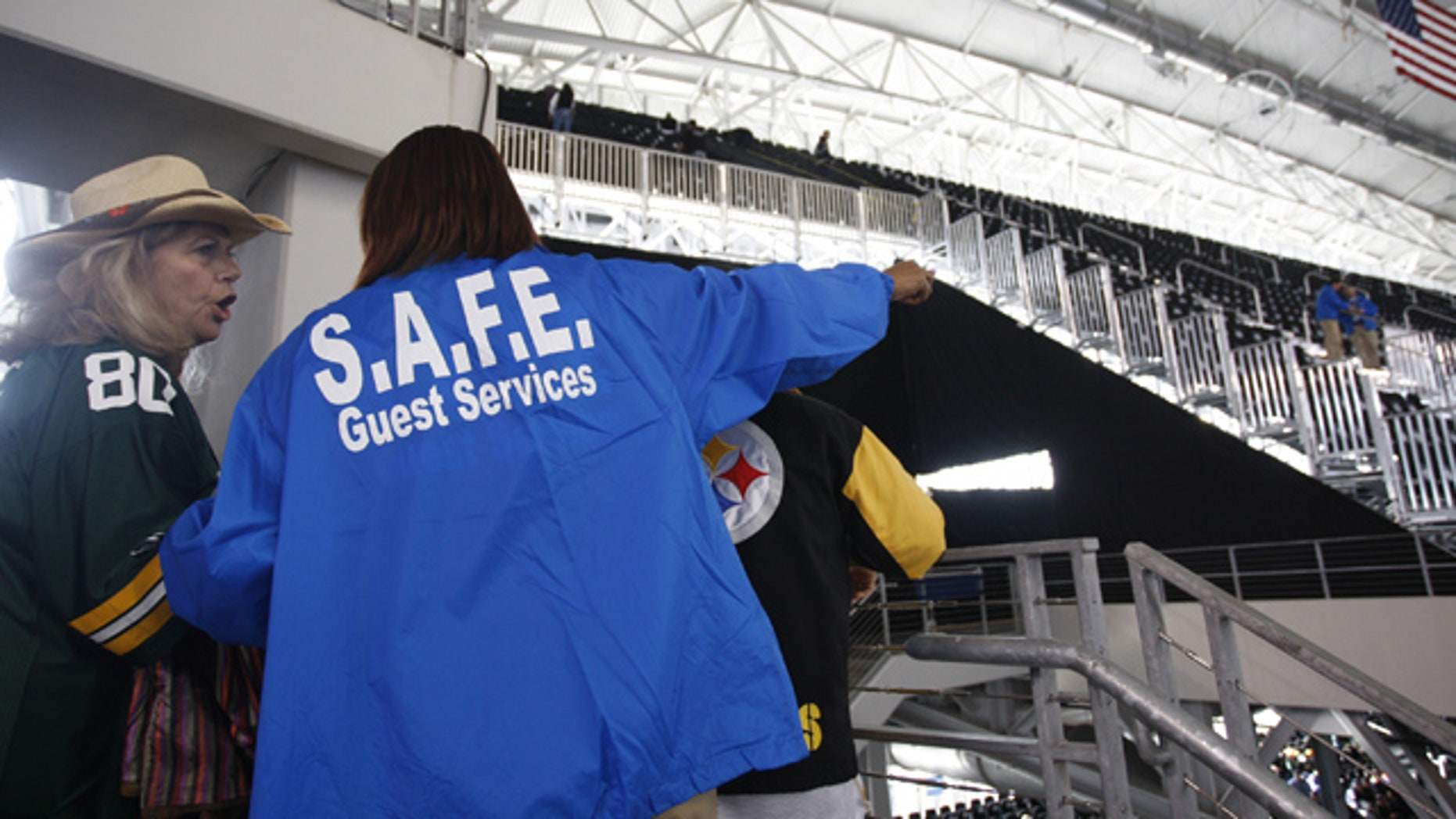 Feb. 6: A ticket-holder, left, and a guest services worker discuss the situation after some fans were denied access to the seats they bought for Super Bowl XLV at Cowboys Stadium in Arlington, Texas.