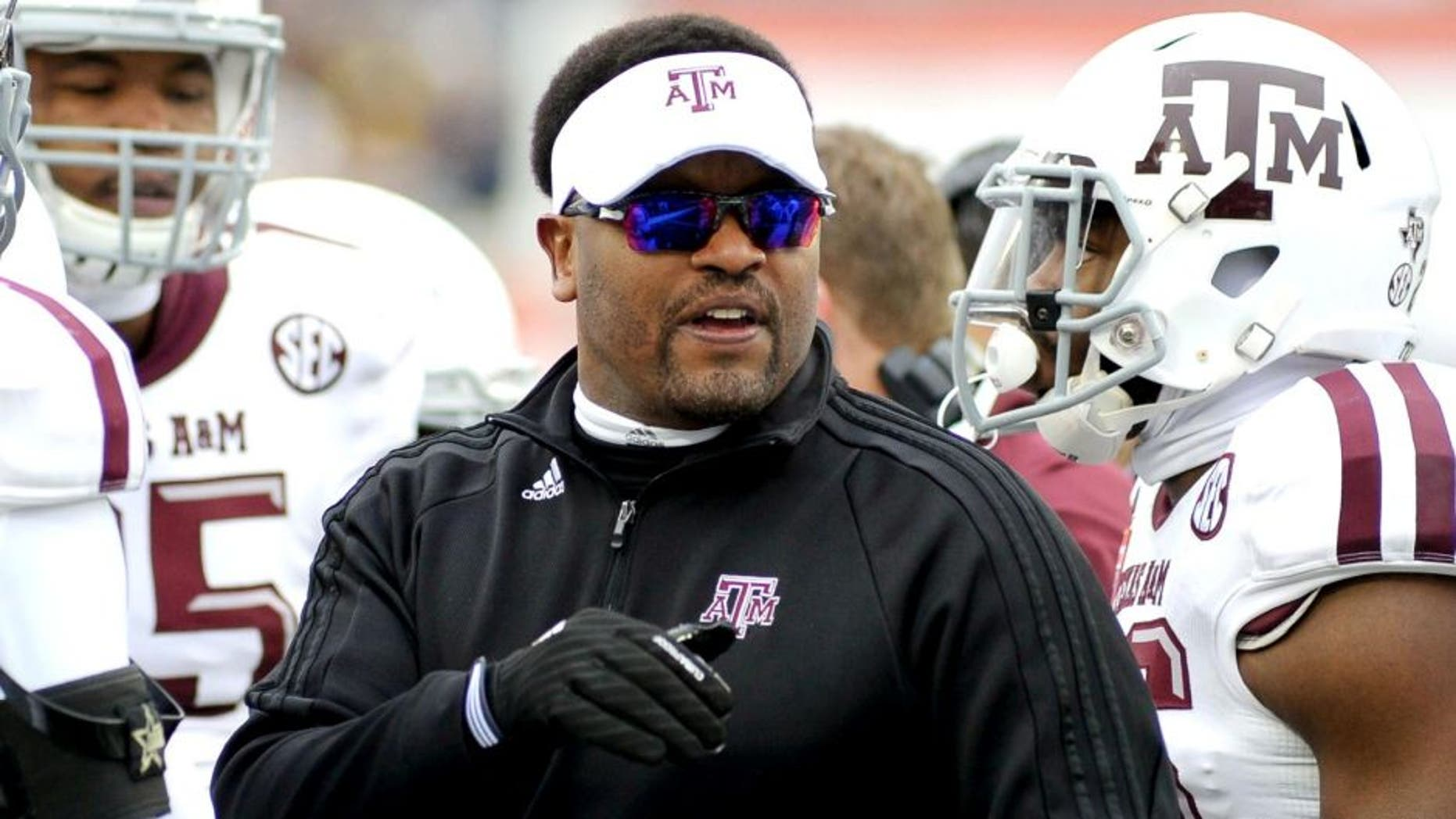Dec 29, 2014; Memphis, TN, USA; Texas A&M Aggies head coach Kevin Sumlin during the game against the West Virginia Mountaineers in the 2014 Liberty Bowl at Liberty Bowl Memorial Stadium. Mandatory Credit: Justin Ford-USA TODAY Sports