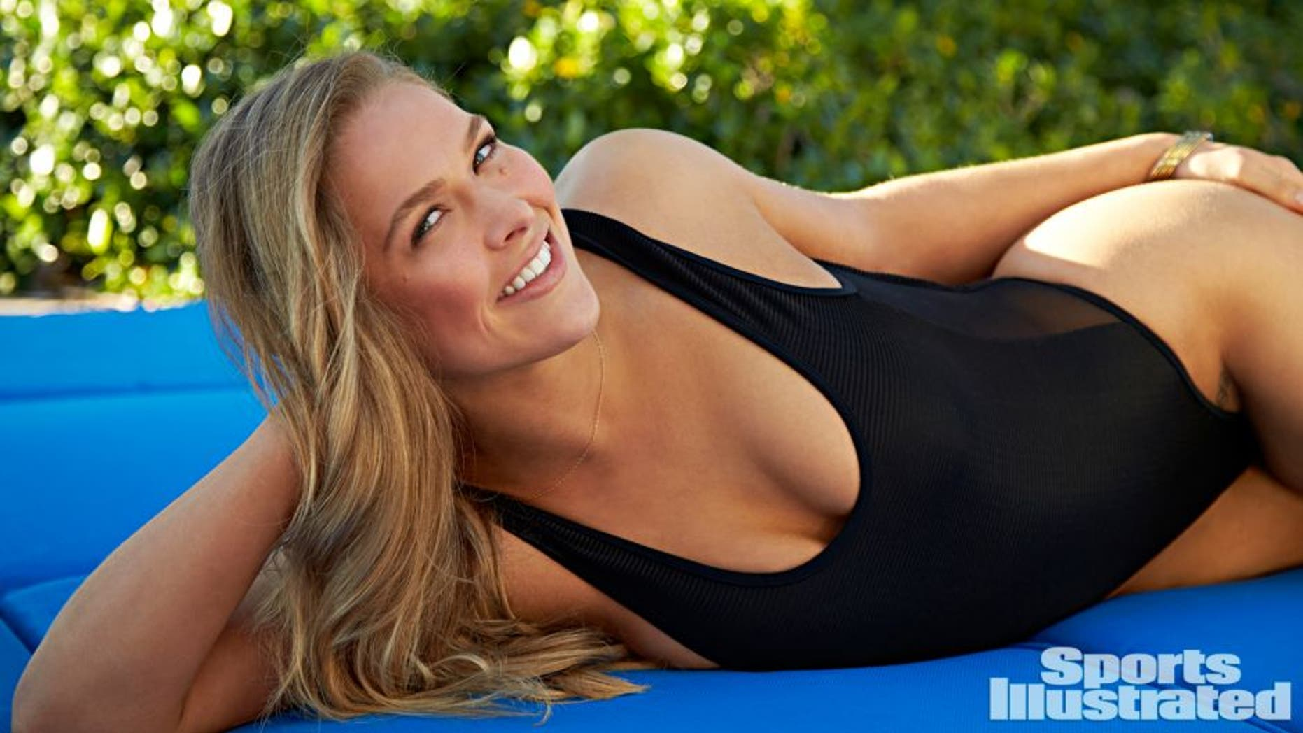 """***NORTH AMERICA usage only, ending February 28, 2015; credit: Walter Iooss Jr./Sports Illustrated; caption must include the words """"on sale now."""" NO INTERNATIONAL USE.*** Swimsuit: 2015 Issue: Portrait of Ronda Rousey during photo shoot at South Seas Island Resort. Swimsuit by Tyler Rose Swimwear. Captiva Island, FL 11/11/2014 CREDIT: Walter Iooss Jr. SetNumber: X158908 TK1"""