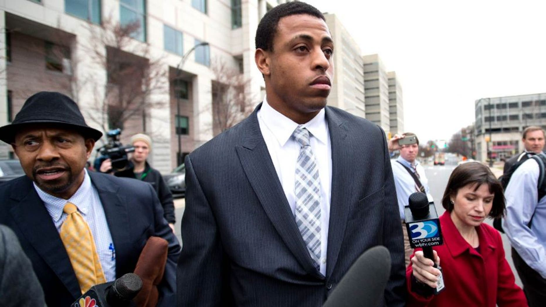 Carolina Panthers' Greg Hardy leaves the Mecklenburg County Courthouse after his domestic violence charges were dismissed in Charlotte, N.C., Monday, Feb. 9, 2015. (AP Photo/Chris Keane)