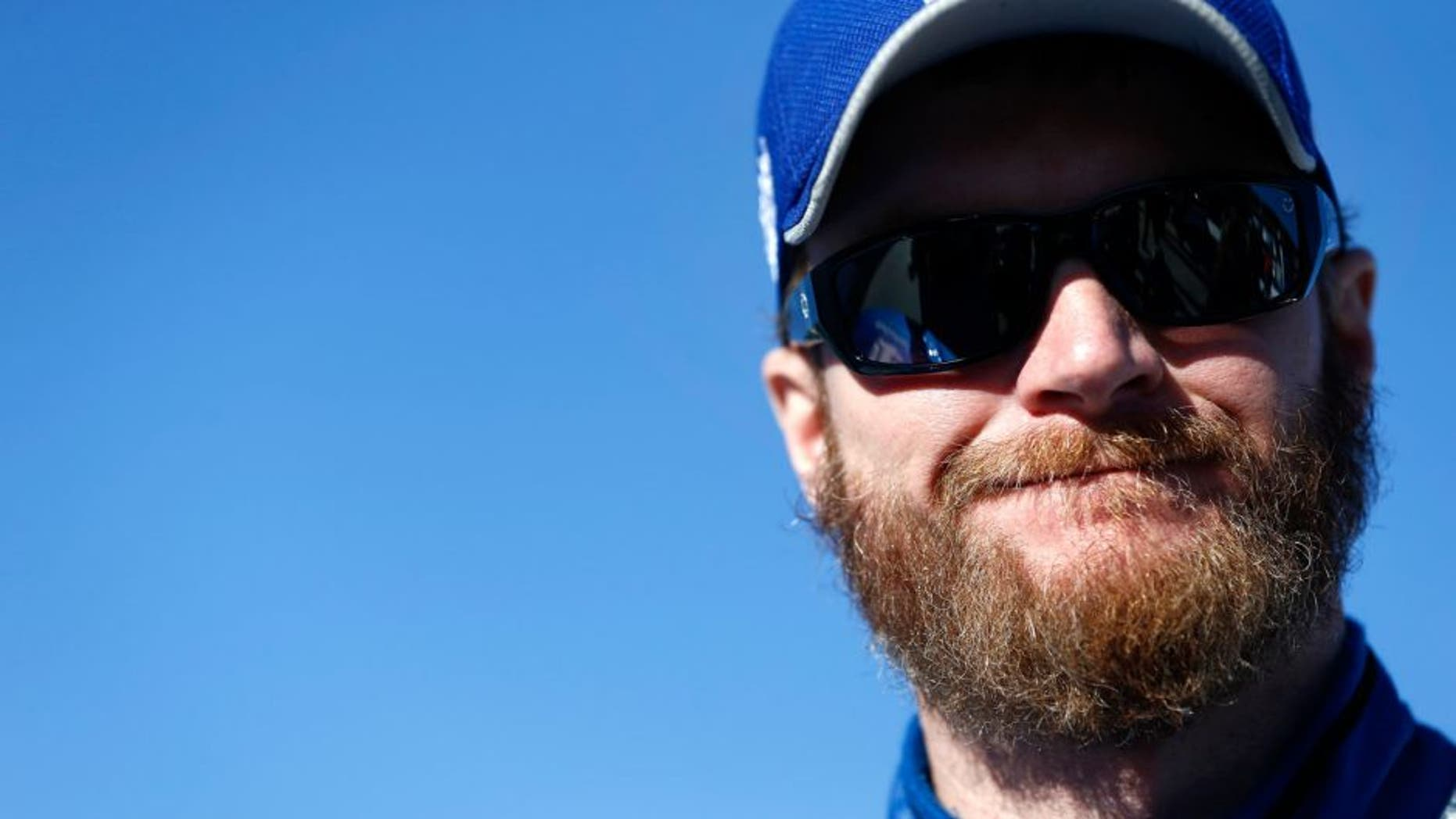 MARTINSVILLE, VA - OCTOBER 30: Dale Earnhardt Jr., driver of the #88 Nationwide Chevrolet, stands on the grid during qualifying for the NASCAR Sprint Cup Series Goody's Headache Relief Shot 500 at Martinsville Speedway on October 30, 2015 in Martinsville, Virginia. (Photo by Jeff Zelevansky/Getty Images)