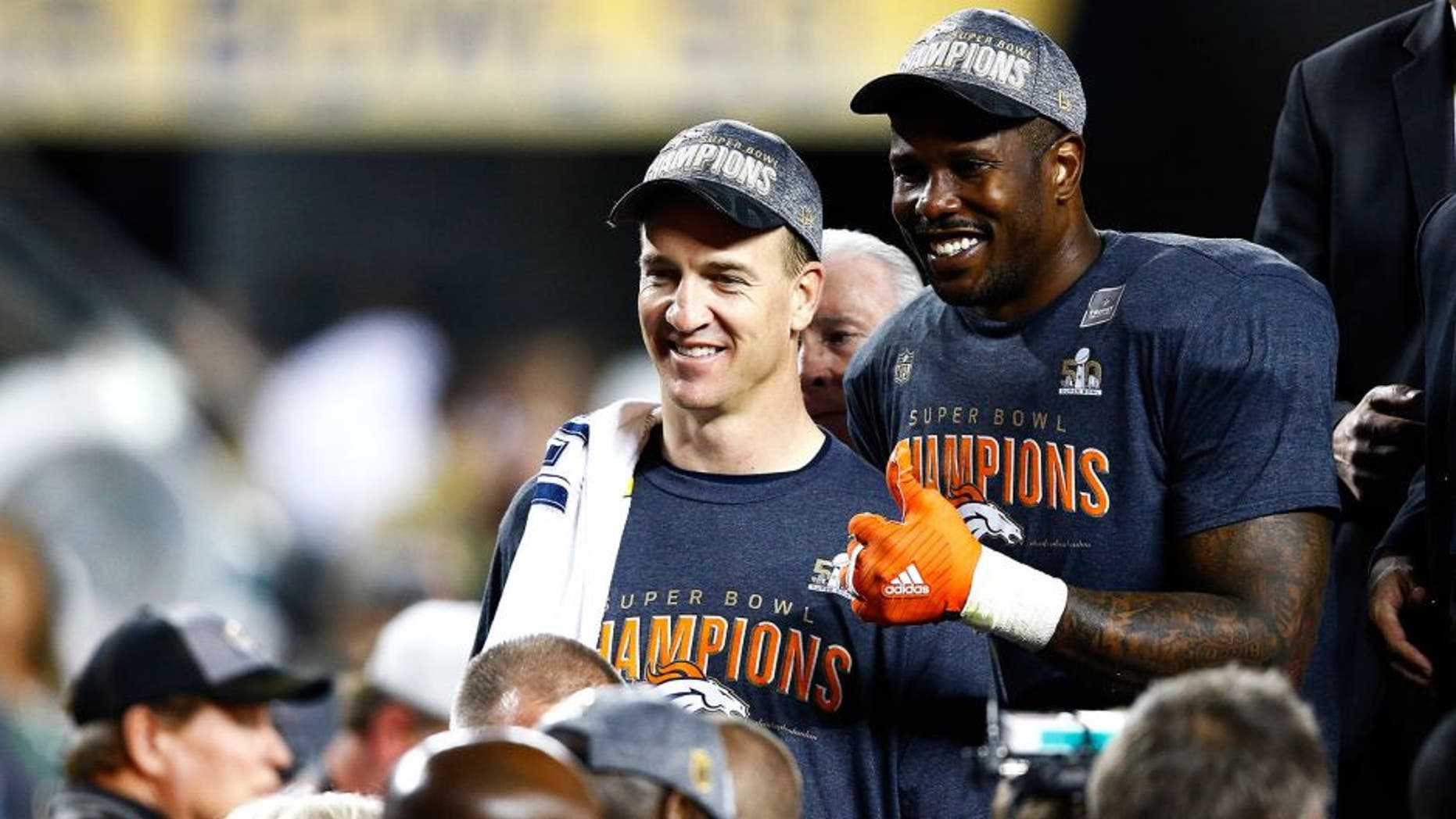 SANTA CLARA, CA - FEBRUARY 07: Peyton Manning #18 and Von Miller #58 of the Denver Broncos celebrate after defeating the Carolina Panthers during Super Bowl 50 at Levi's Stadium on February 7, 2016 in Santa Clara, California. The Broncos defeated the Panthers 24-10. (Photo by Al Bello/Getty Images)