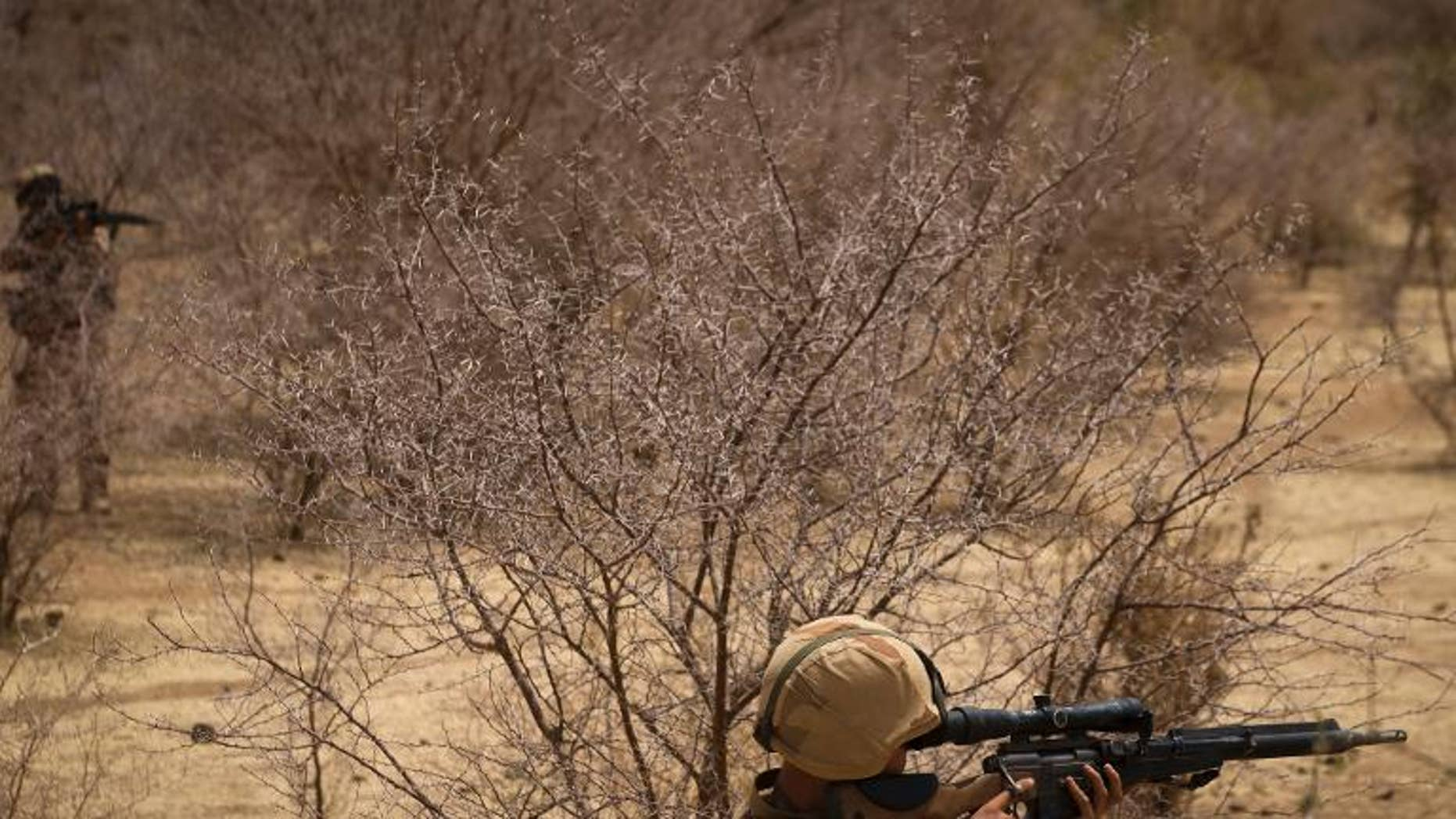 A French soldier takes part in a hunt for Islamist fighters in a valley in northern Mali on April 10, 2013