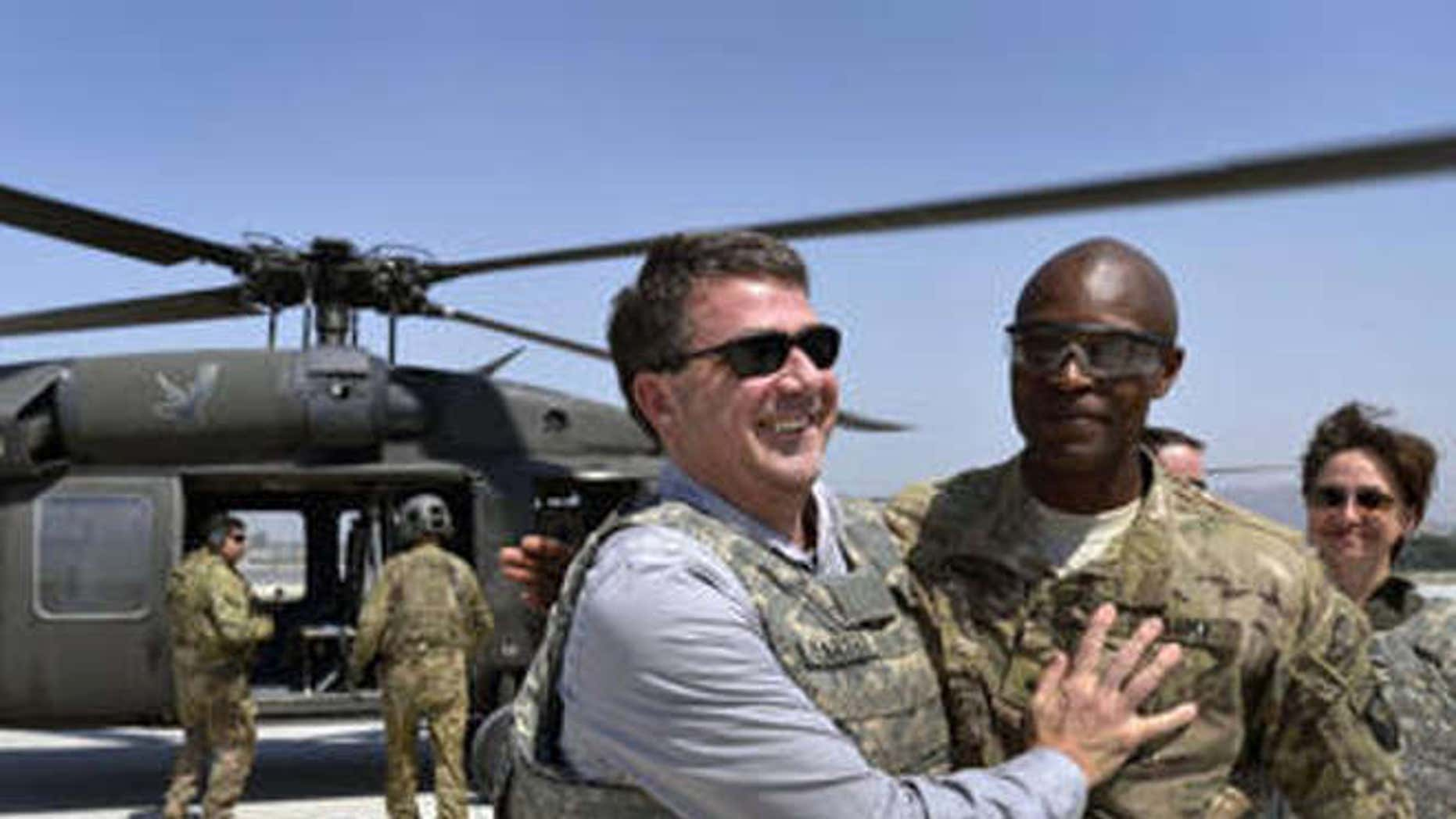 Former Defense Secretary Ash Carter with Maj. Gen. Ronald Lewis