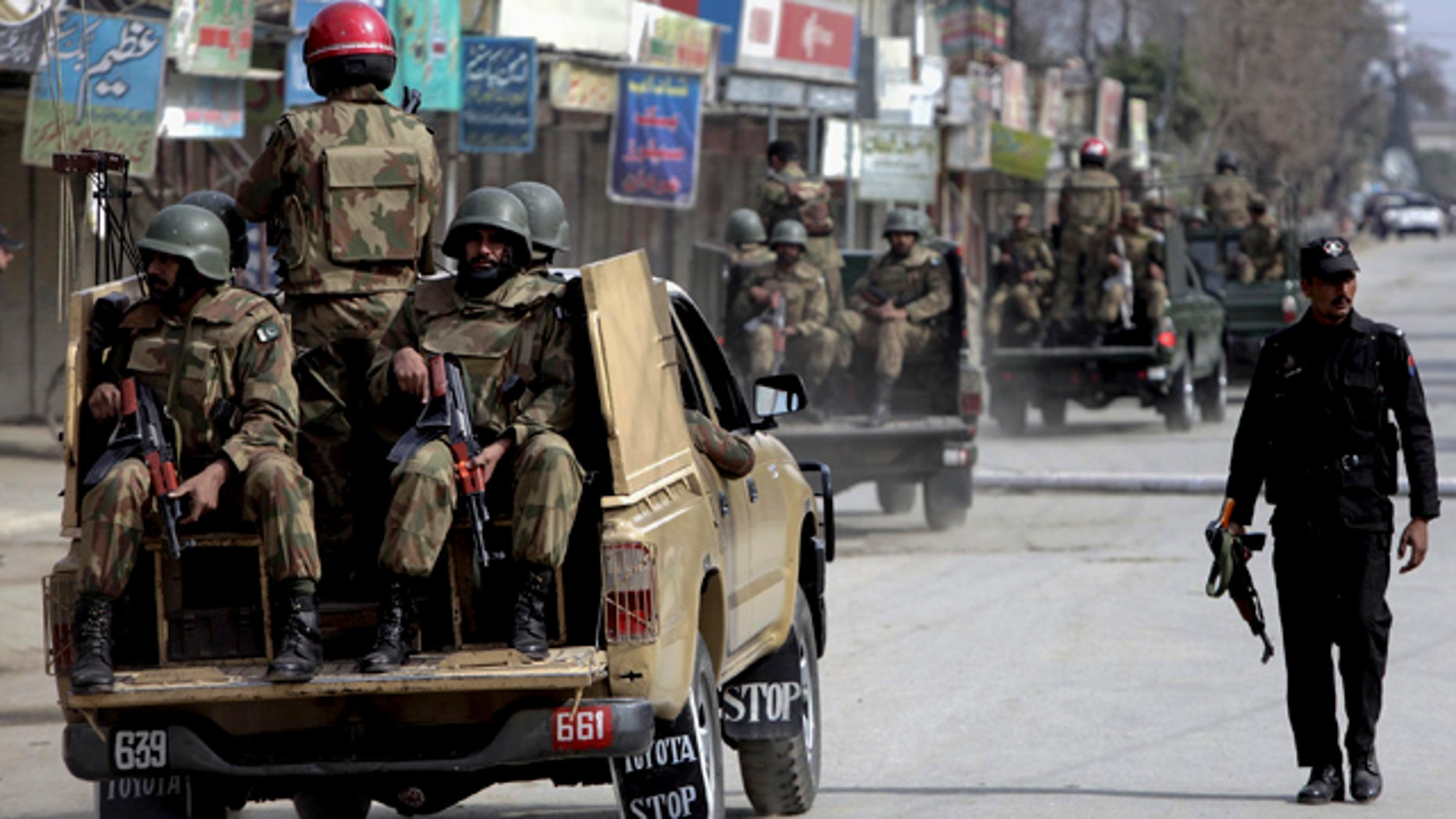 Feb. 10: Pakistan army soldiers patrol in the vicinity of the army training camp in Mardan near Peshawar, Pakistan.