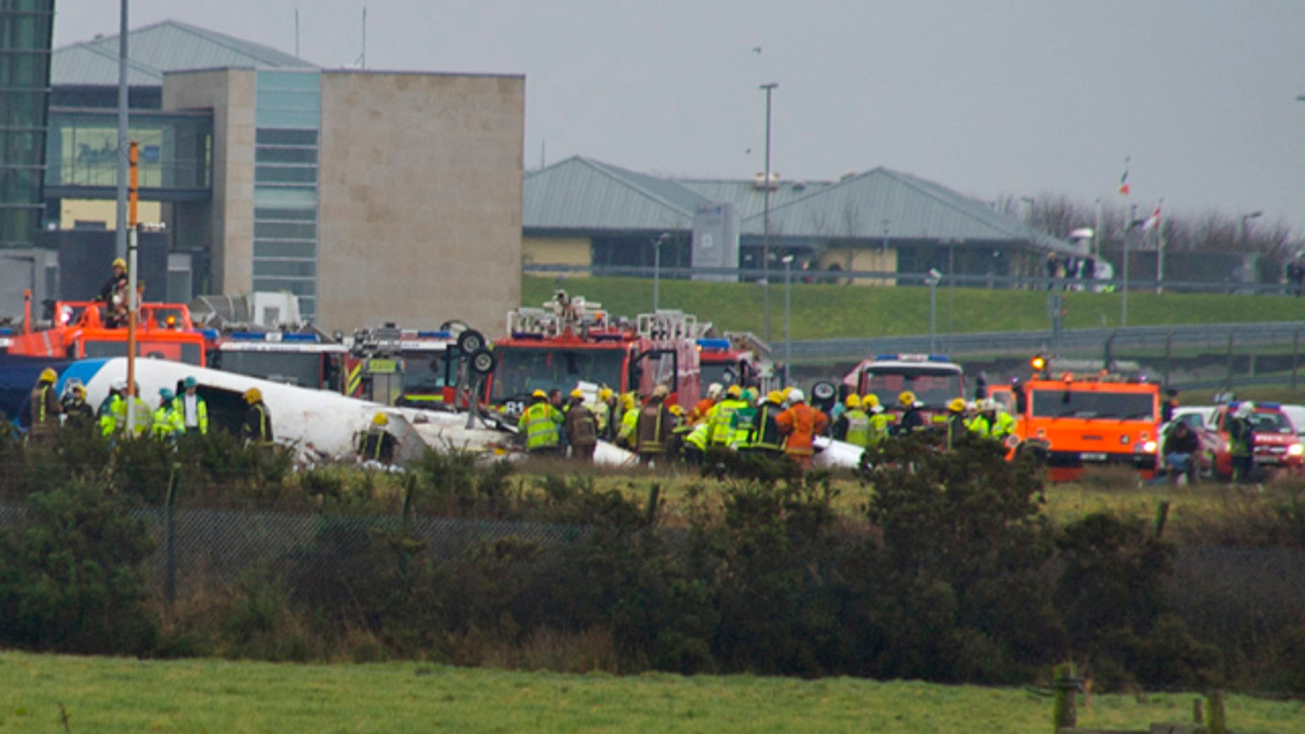 Feb. 10: Emergency services attend the scene after a small commuter aircraft carrying 12 people crashed as it tried to land in heavy fog at Cork Airport in southwest Ireland.