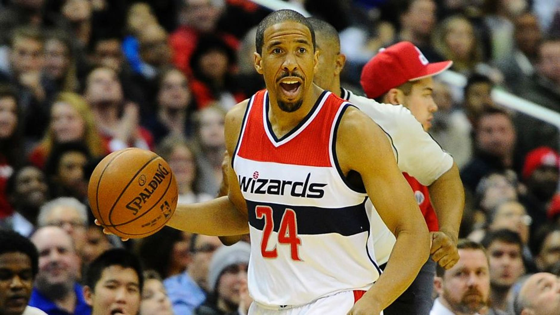 Jan 13, 2015; Washington, DC, USA; Washington Wizards guard Andre Miller (24) advances the ball against the San Antonio Spurs during the second half at Verizon Center. The Wizards won 101-93. Mandatory Credit: Brad Mills-USA TODAY Sports