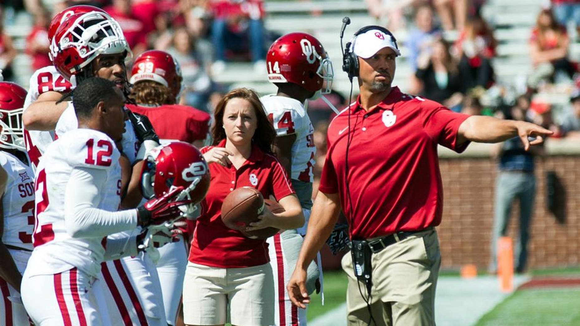 Apr 11, 2015; Norman, OK, USA; Oklahoma Sooners defensive line coach Diron Reynolds directs players during the spring football game at Gaylord Family Oklahoma Memorial Stadium. Red wins 20-7 over White. Mandatory Credit: Rob Ferguson-USA TODAY Sports