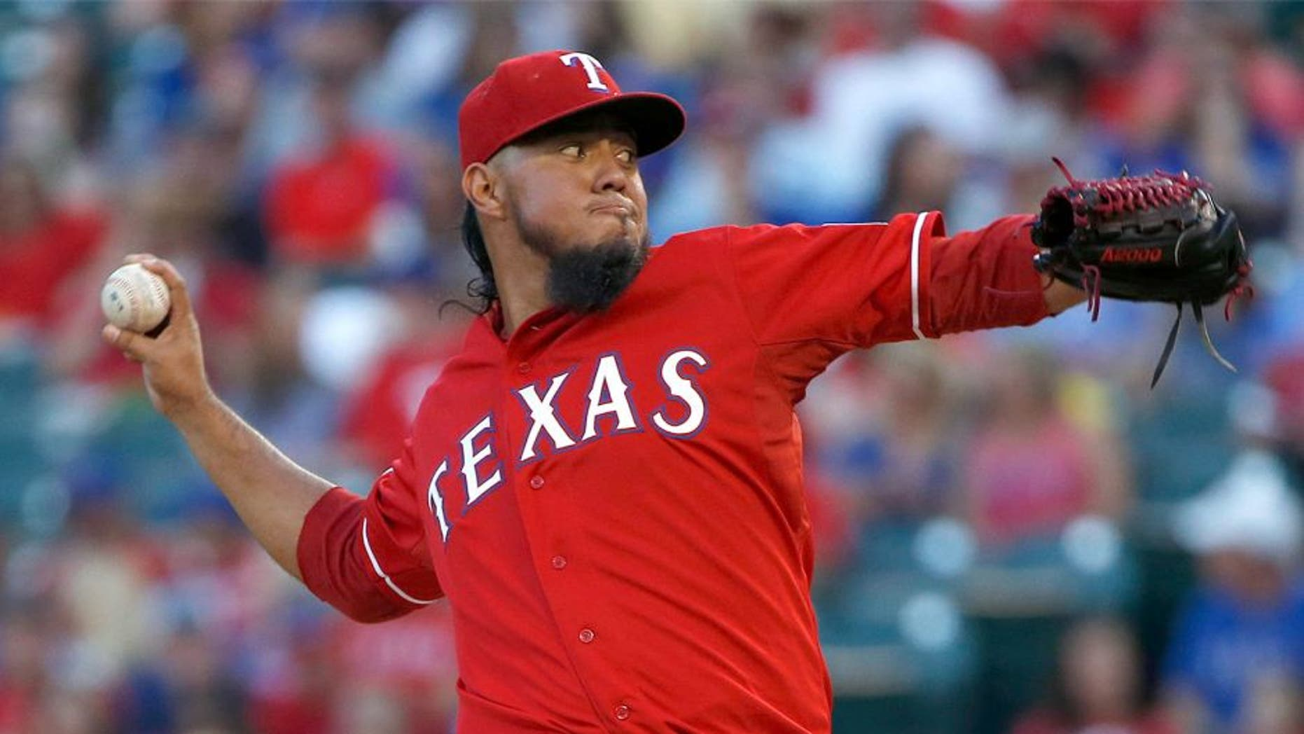 ARLINGTON, TX - SEPTEMBER 12: Yovani Gallardo #49 of the Texas Rangers pitches against the Oakland Athletics in the top of the first inning at Globe Life Park in Arlington on September 12, 2015 in Arlington, Texas. (Photo by Ron Jenkins/Getty Images)