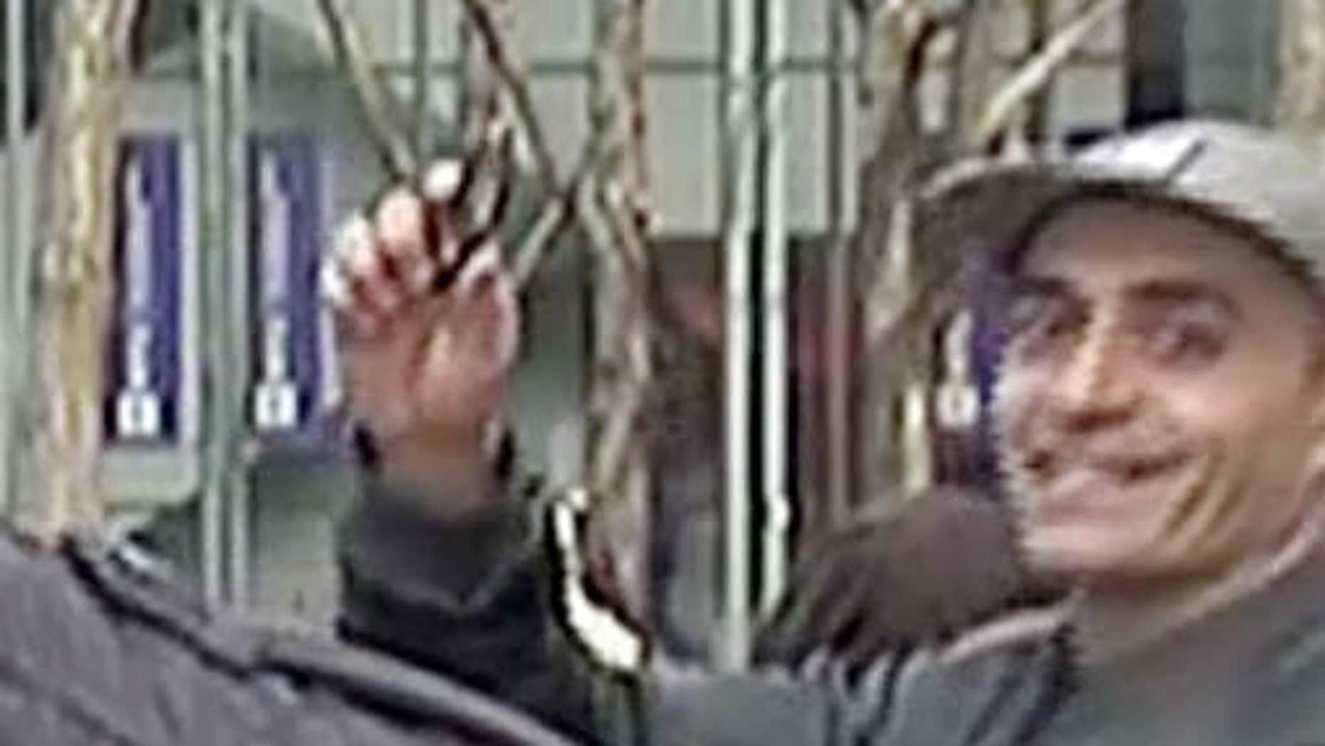 Feb. 10, 2016: In this image taken from WNBC-TV video, a man appears to wave a handgun behind a television news reporter during a live broadcast in New York City