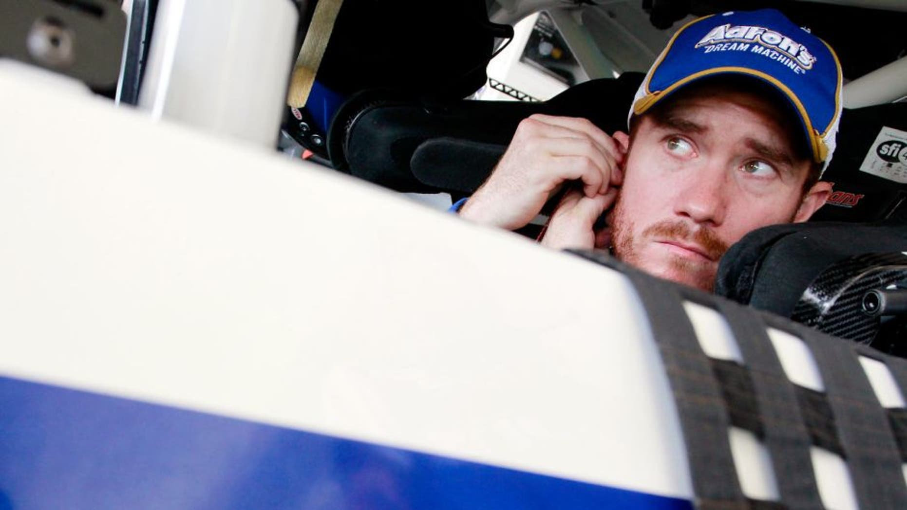 HOMESTEAD, FL - NOVEMBER 15: Brian Vickers, driver of the #55 Aaron's Dream Machine Toyota, sits in his car in the garage area during practice for the NASCAR Sprint Cup Series Ford EcoBoost 400 at Homestead-Miami Speedway on November 15, 2014 in Homestead, Florida. (Photo by Brian Lawdermilk/Getty Images)