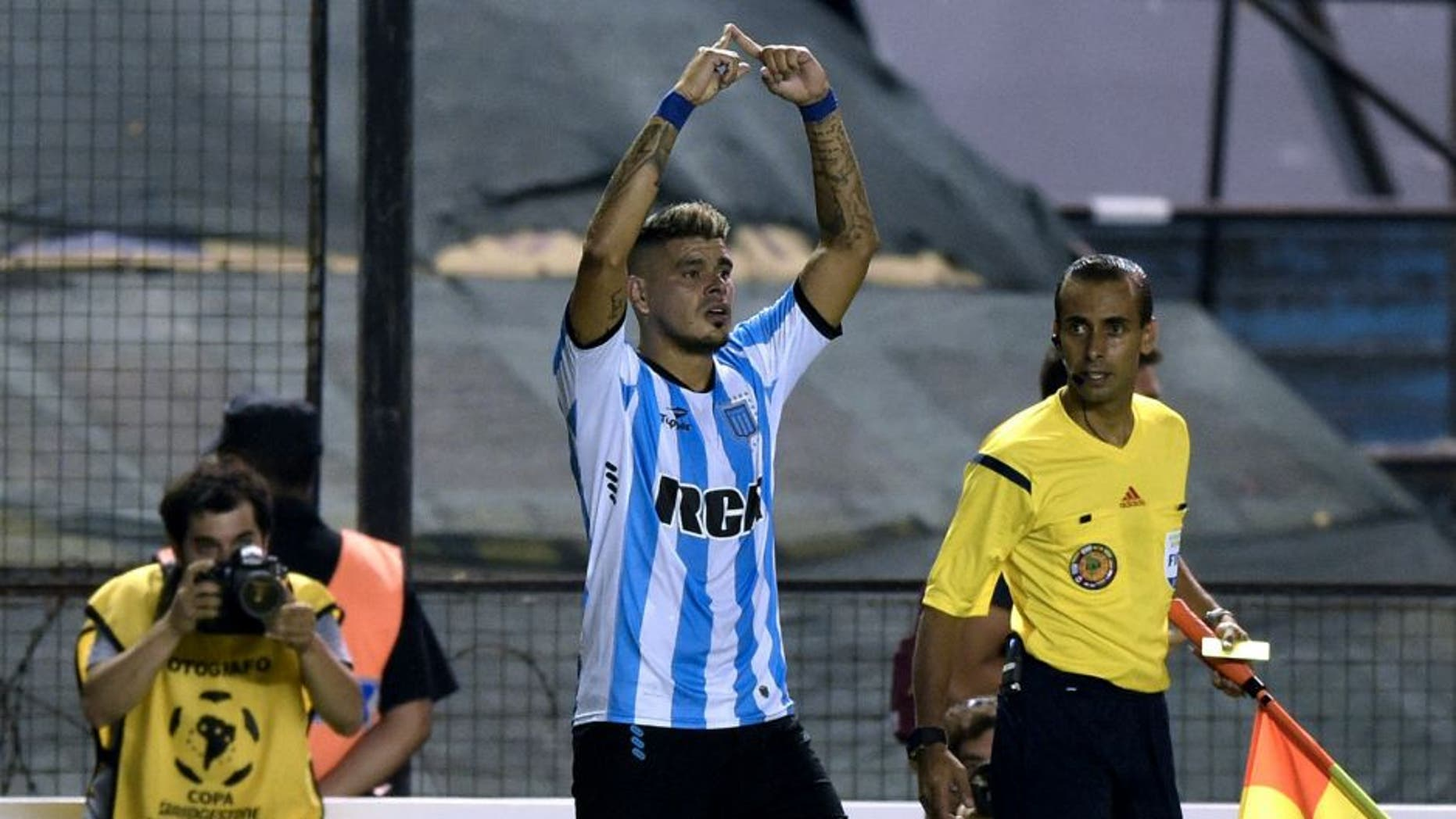 Argentina's Racing Club forward Gustavo Bou (C) celebrates after scoring a goal against Mexico's Puebla during the Copa Libertadores 2016 football match at Juan Domingo Peron stadium in Avellaneda, Buenos Aires, Argentina, on February 10, 2016. AFP PHOTO / JUAN MABROMATA / AFP / JUAN MABROMATA (Photo credit should read JUAN MABROMATA/AFP/Getty Images)