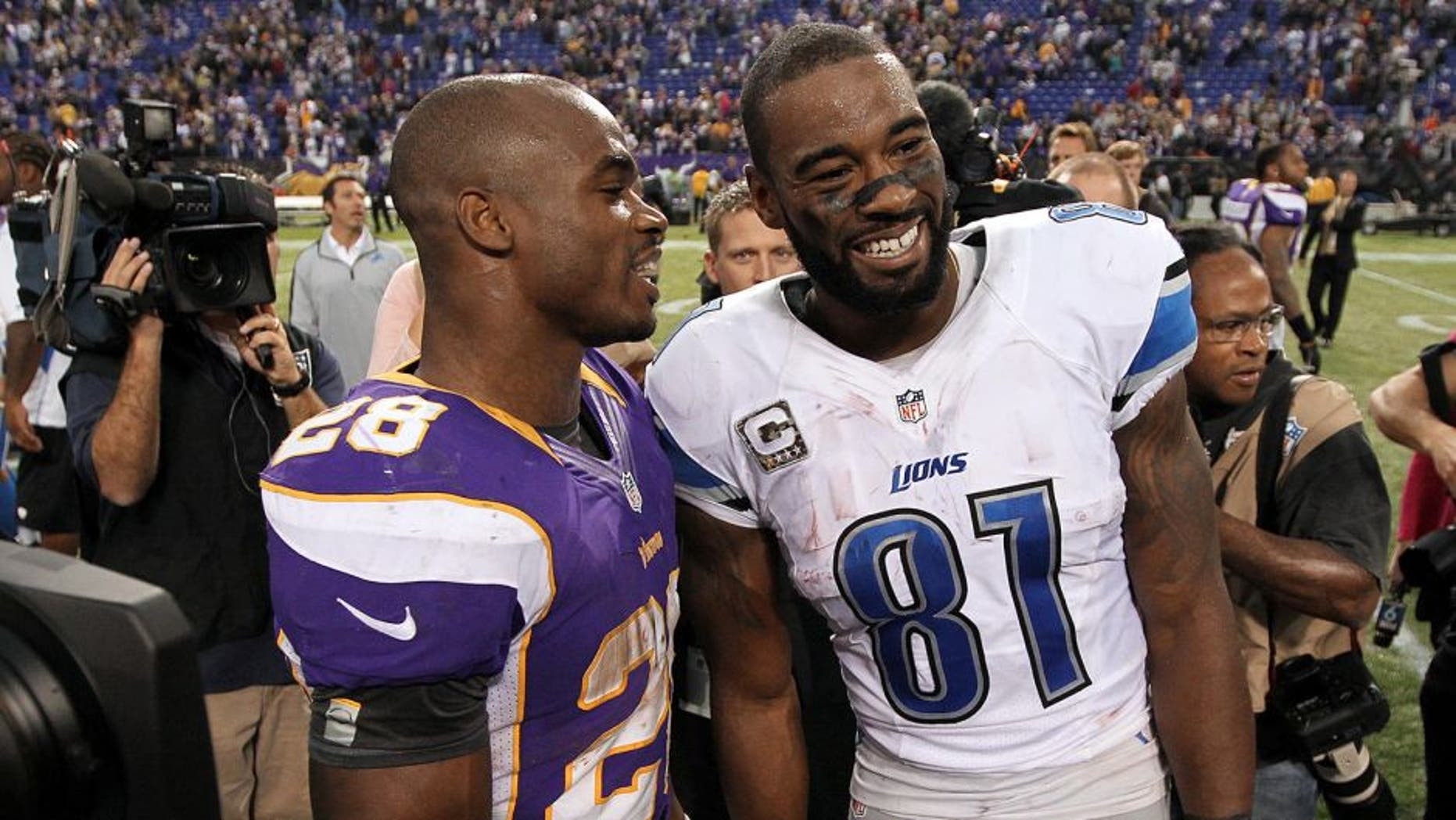 Nov 11, 2012; Minneapolis, MN, USA; Detroit Lions wide receiver Calvin Johnson (81) talks with Minnesota Vikings running back Adrian Peterson (28) following the game at the Metrodome. The Vikings defeated the Lions 34-24. Mandatory Credit: Brace Hemmelgarn-USA TODAY Sports